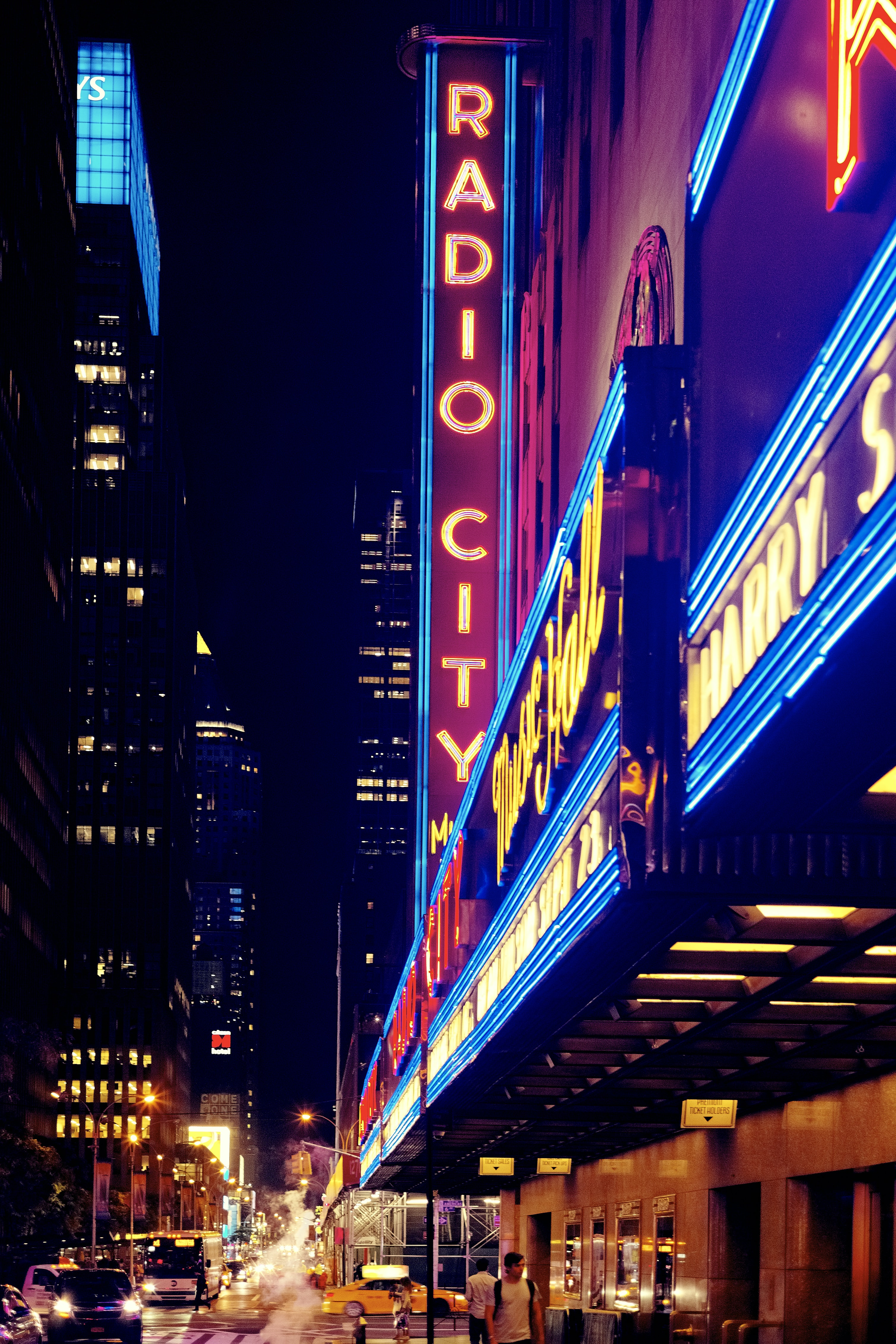 Vertical and horizontal neons at the entrance to Radio City Music Hall at night