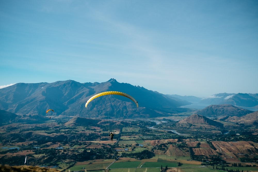 bird's-eye view photography of person in parachute