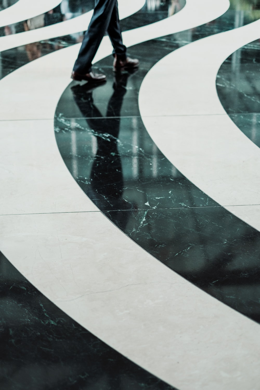 Swirling black and white pattern on a marble floor
