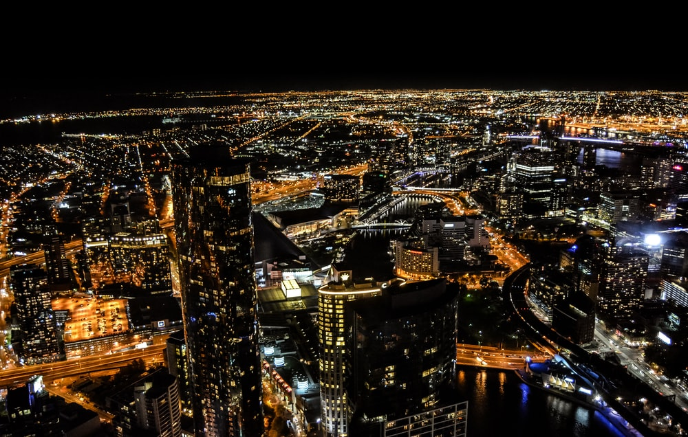 aerial photography of skyscraper at night time