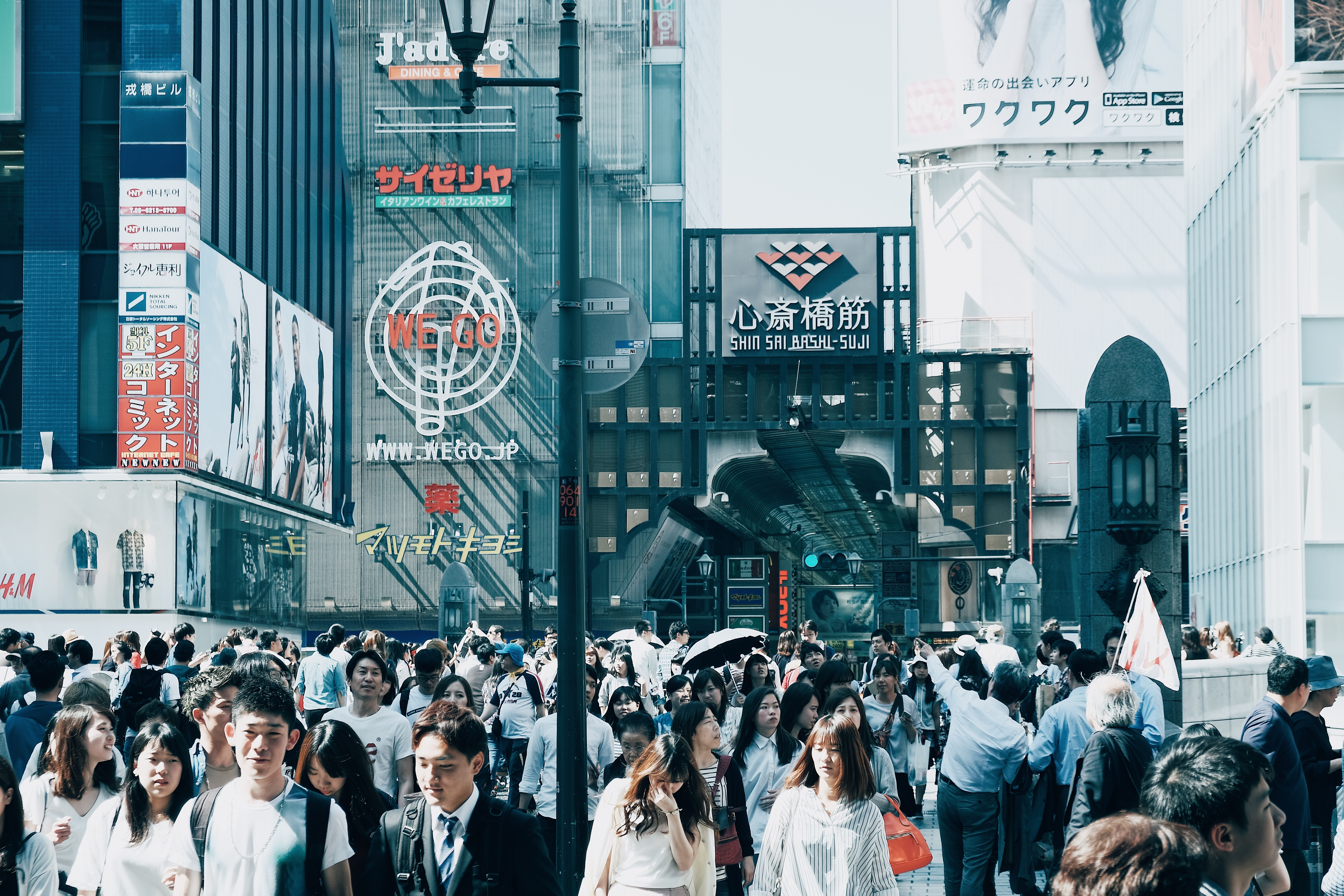 People in business attire in a crowded street in Japan