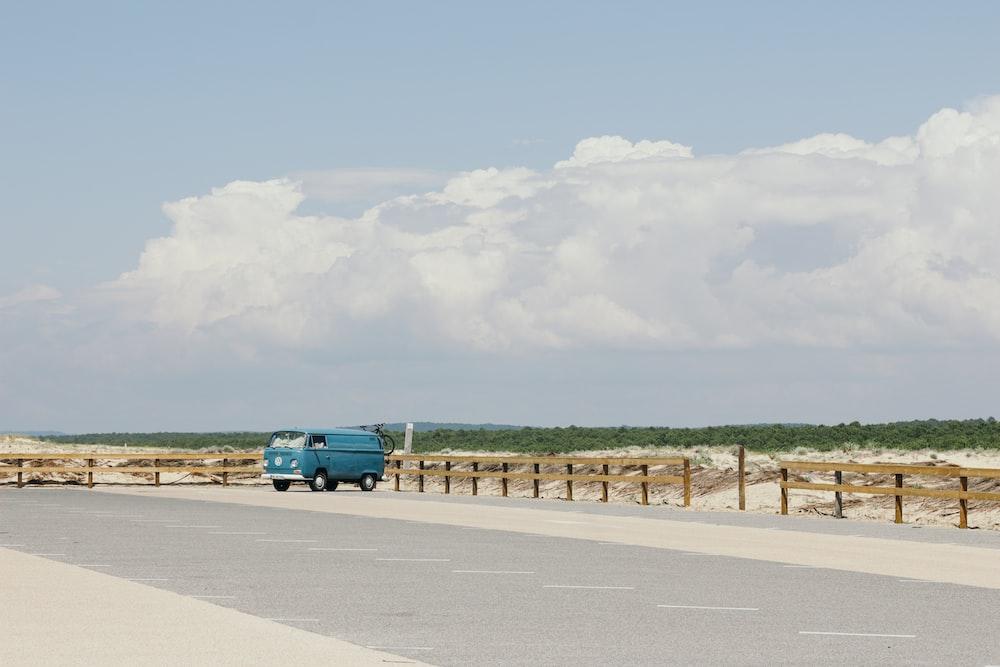 blue van on gray concrete road top