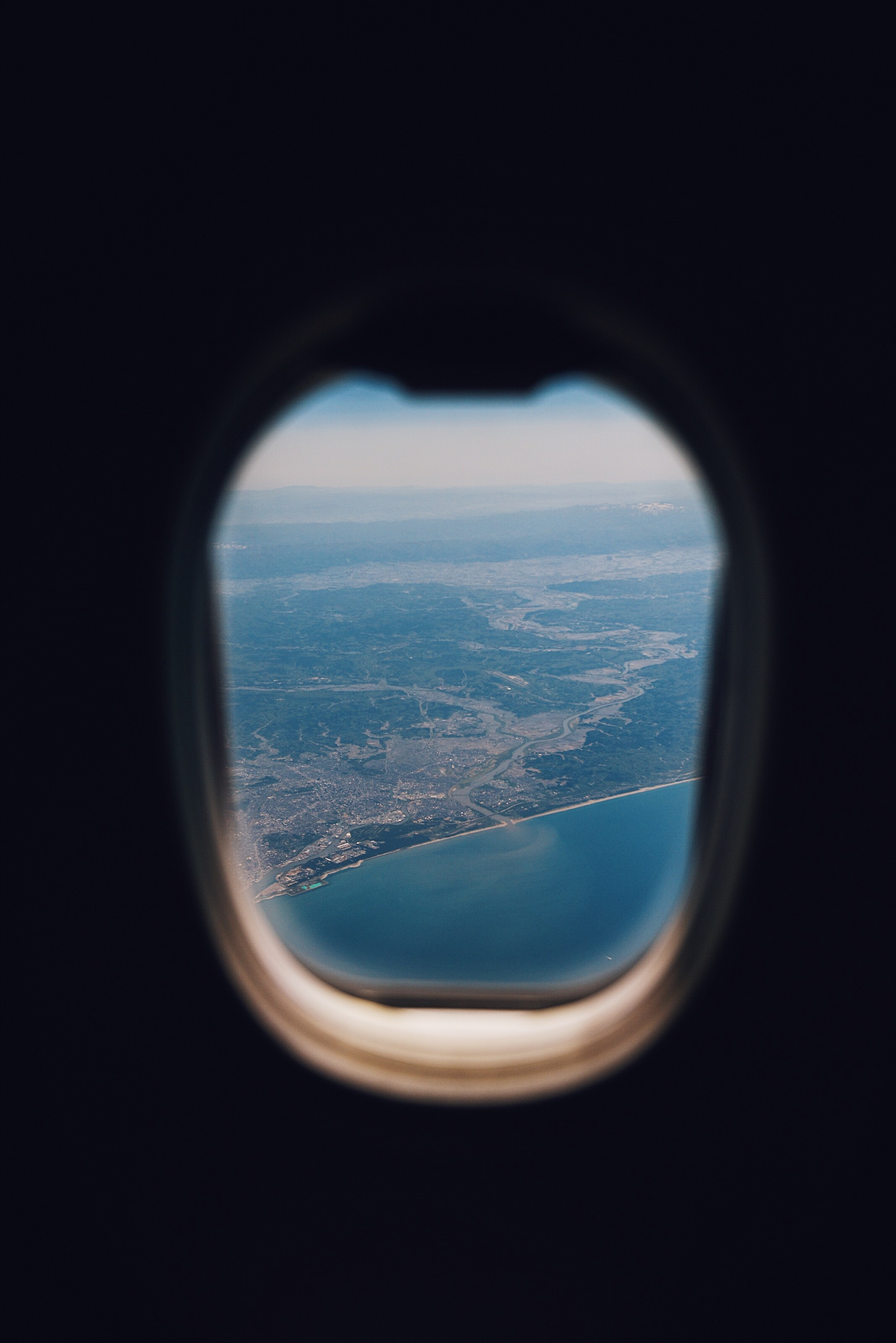 View of a coastline from the window of an airplane.