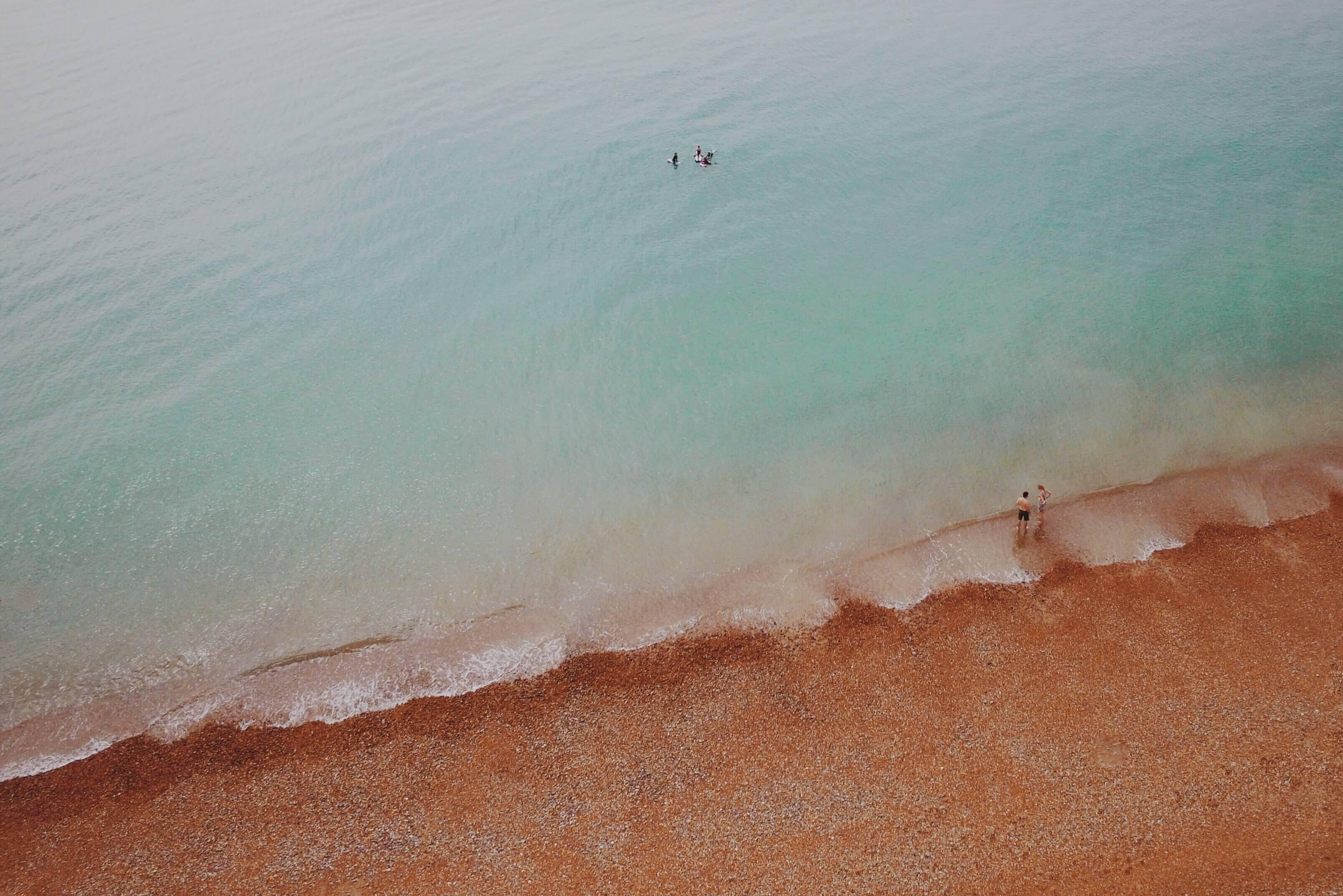 aerial view of people at seashore