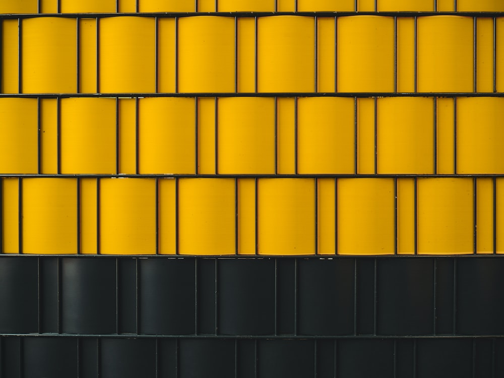 Digital Wallpaper Of Yellow And Black Wall Photo Free Yellow Image On Unsplash