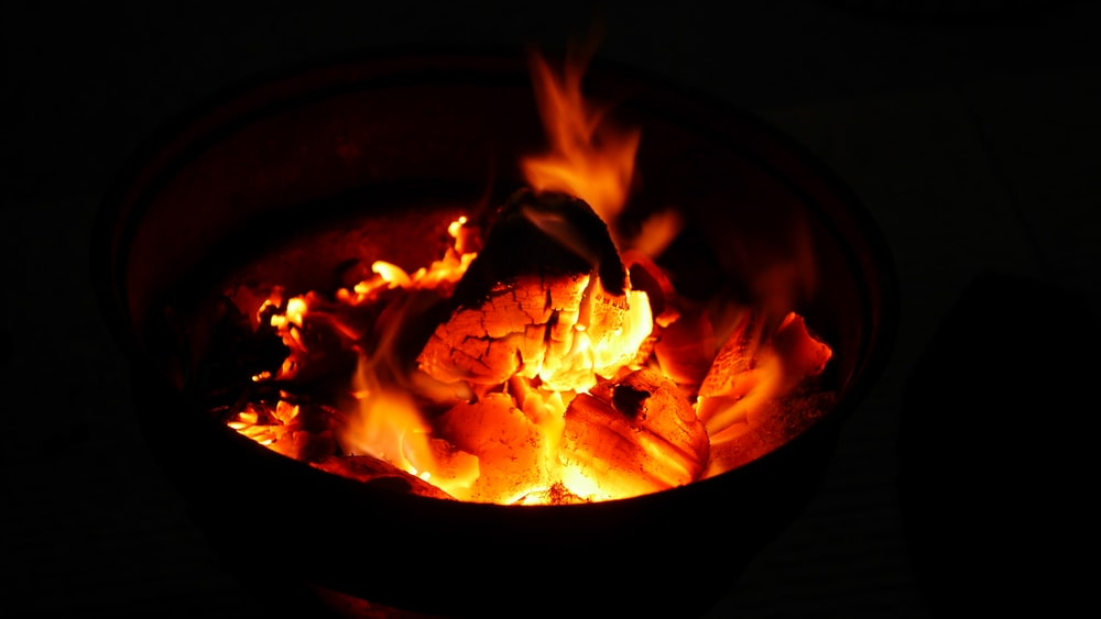 Burning wood and orange coals in a fire