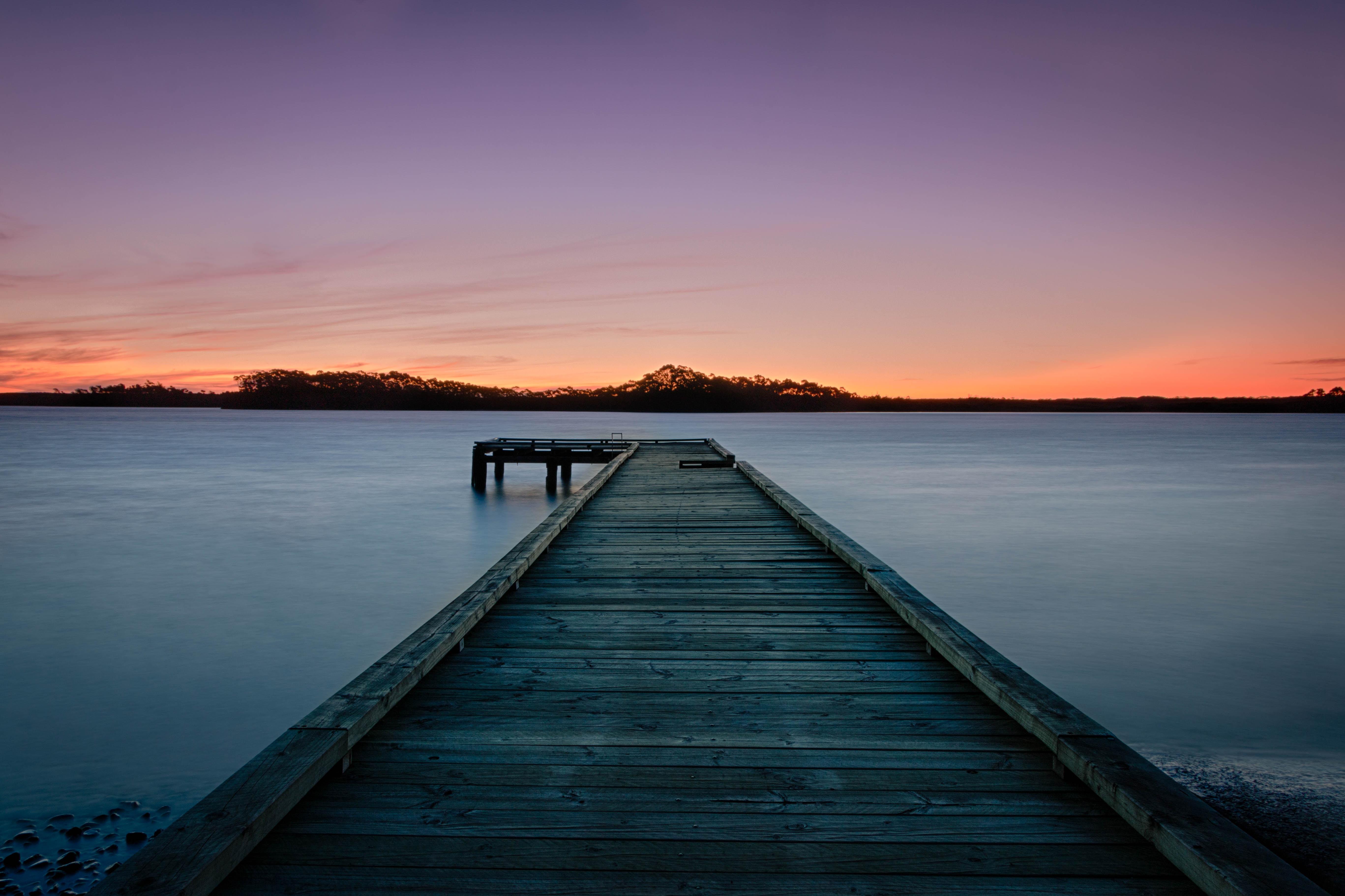 Long exposure sunset by the pier in Strahan, Tasmania, Australia