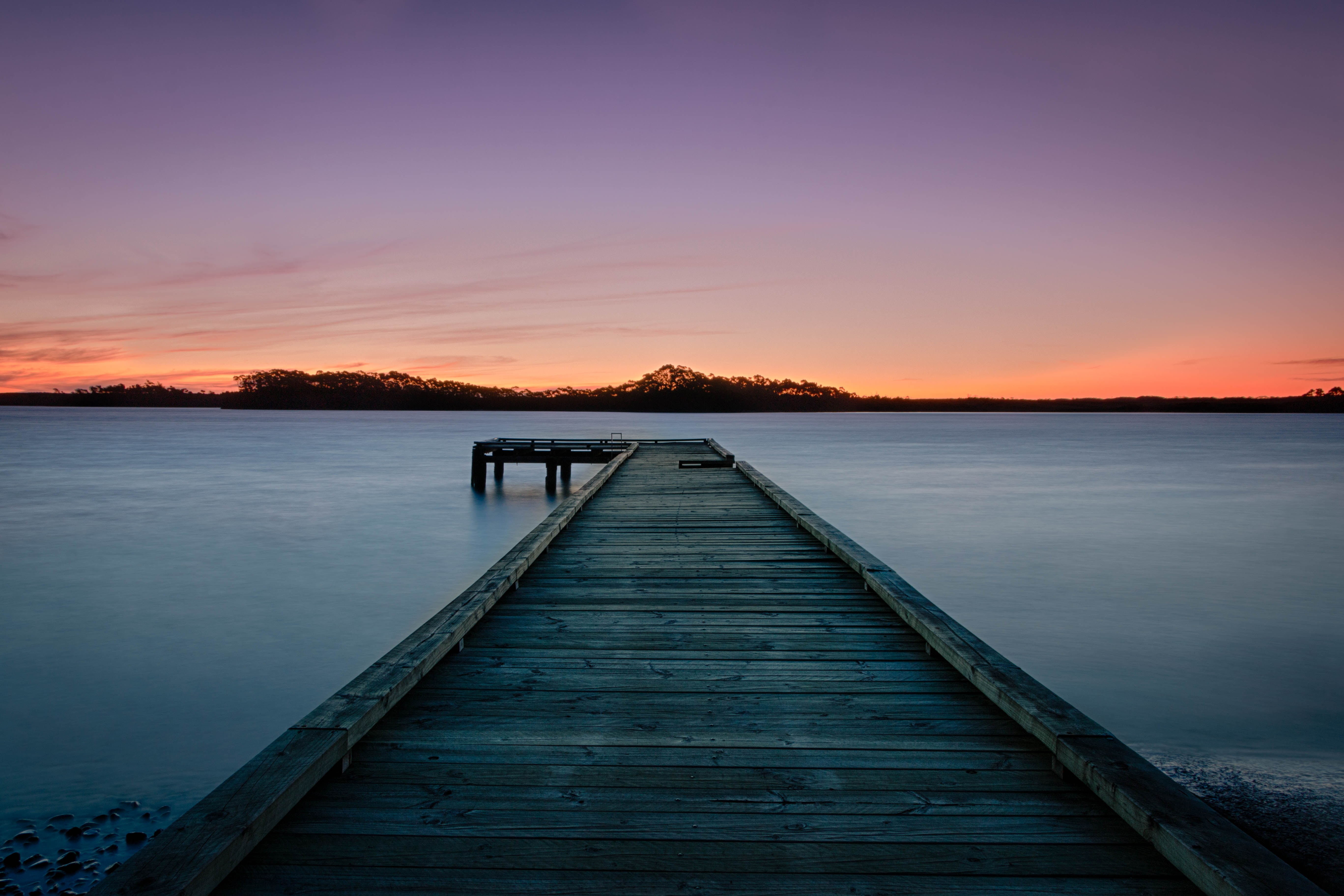 Long exposure sunset by the pier in Strahan, Tasmania, Australia