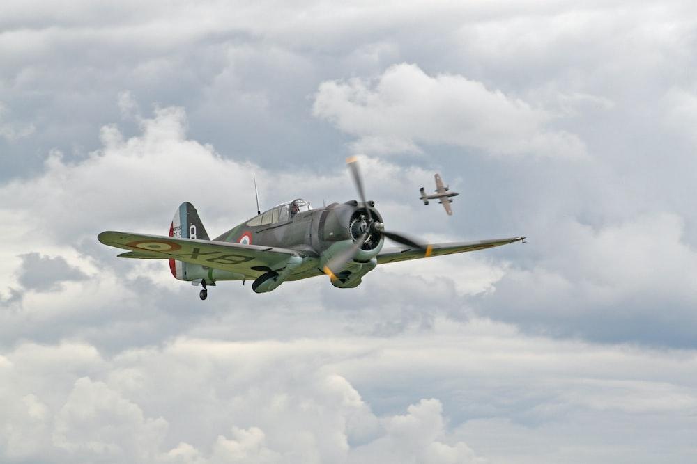 black fighter jet flew in mid air
