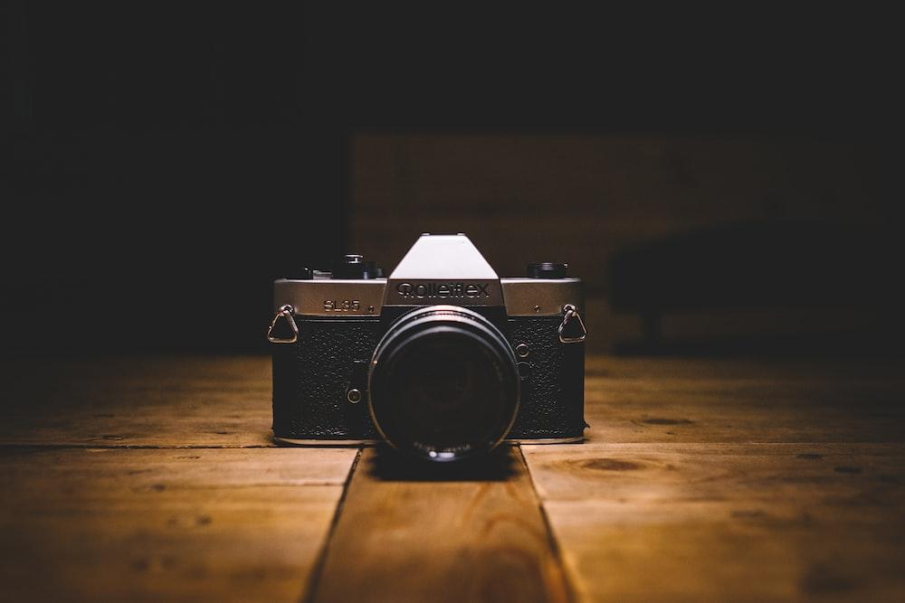 black and gray SLR camera on floor