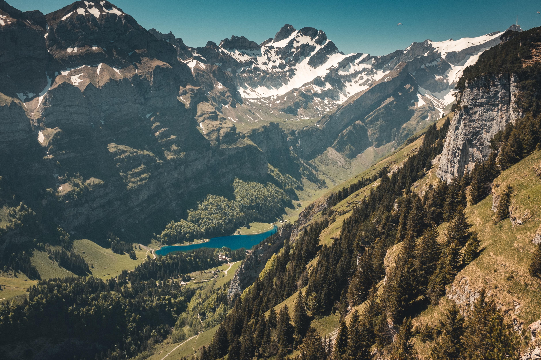 An azure lake in a deep mountain valley