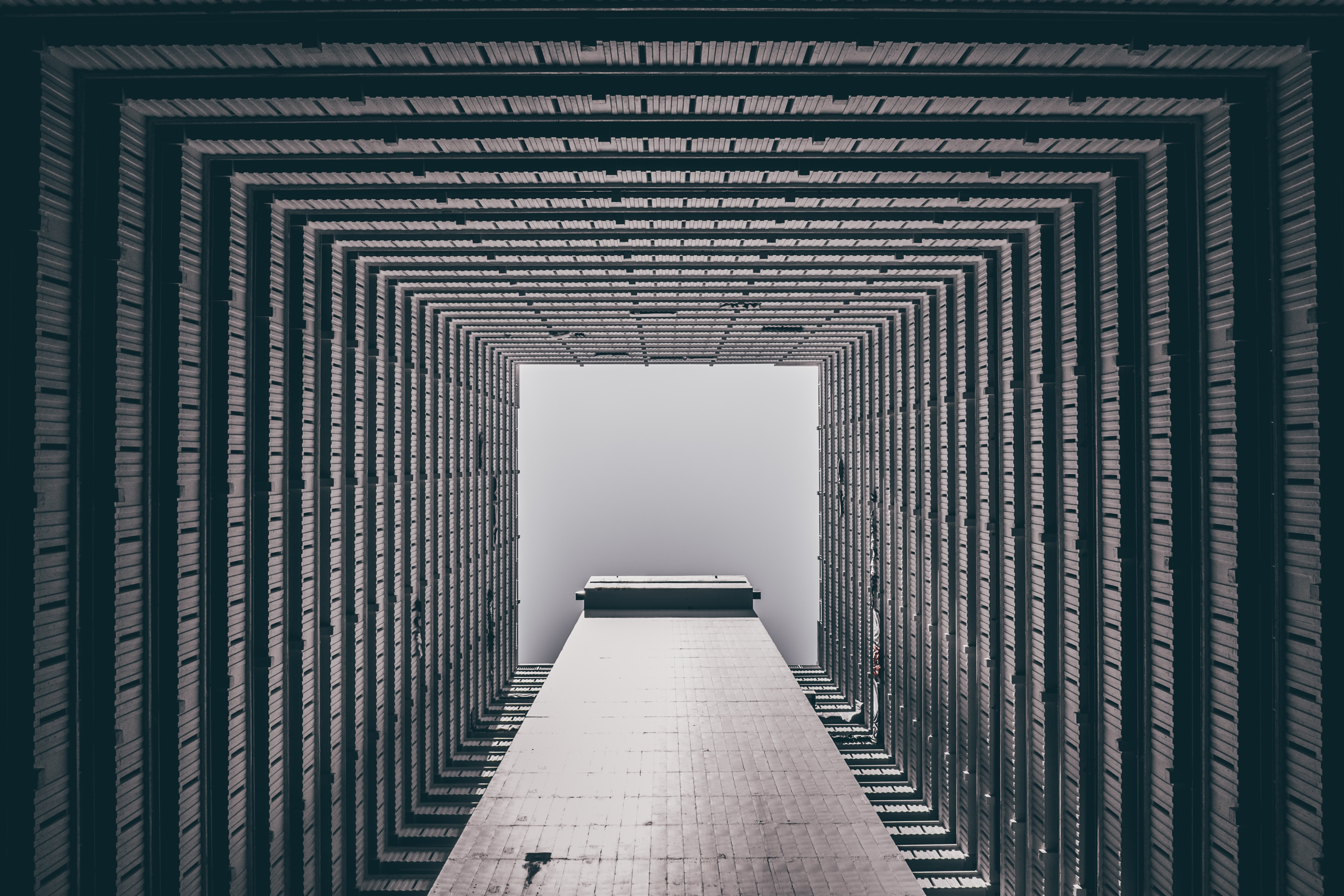 A hypnotizing image of a building hall in Hong Kong with trippy square patterns