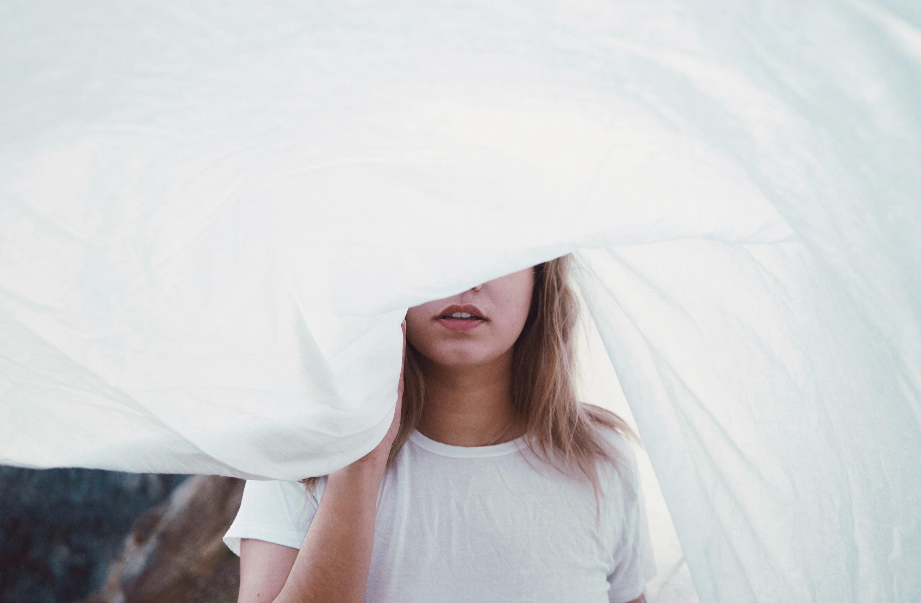 woman under white cloth