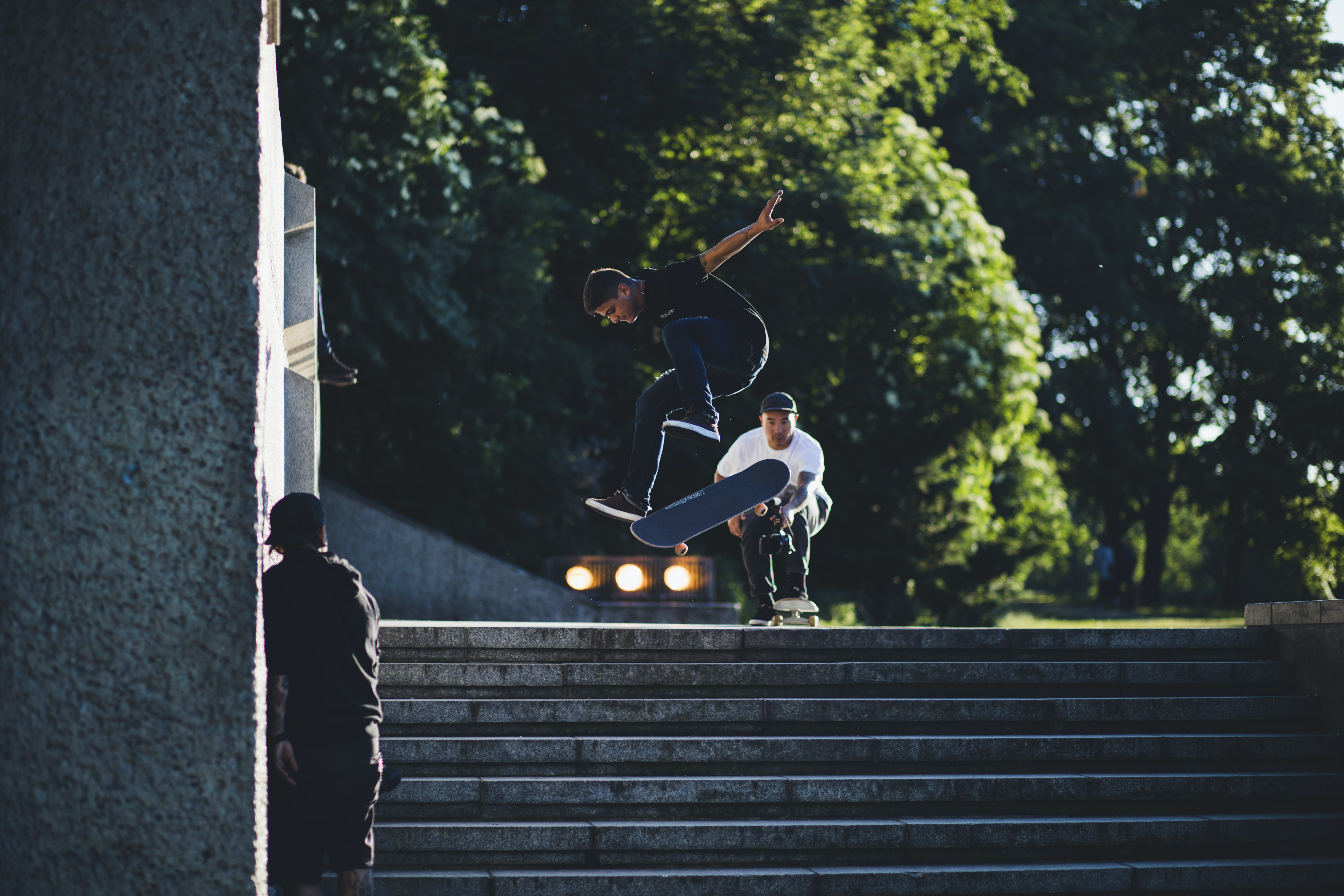 Skateboarders do trick jumps down stairs
