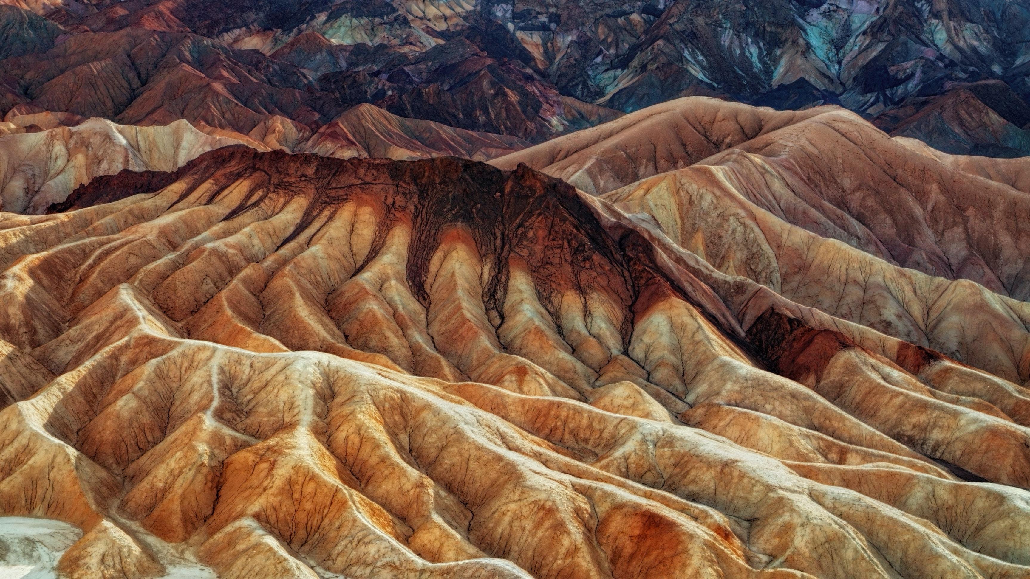 An aerial shot of barren fold mountains in Zabriskie Point