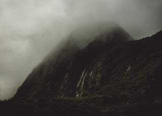 gray mountain covered by white clouds