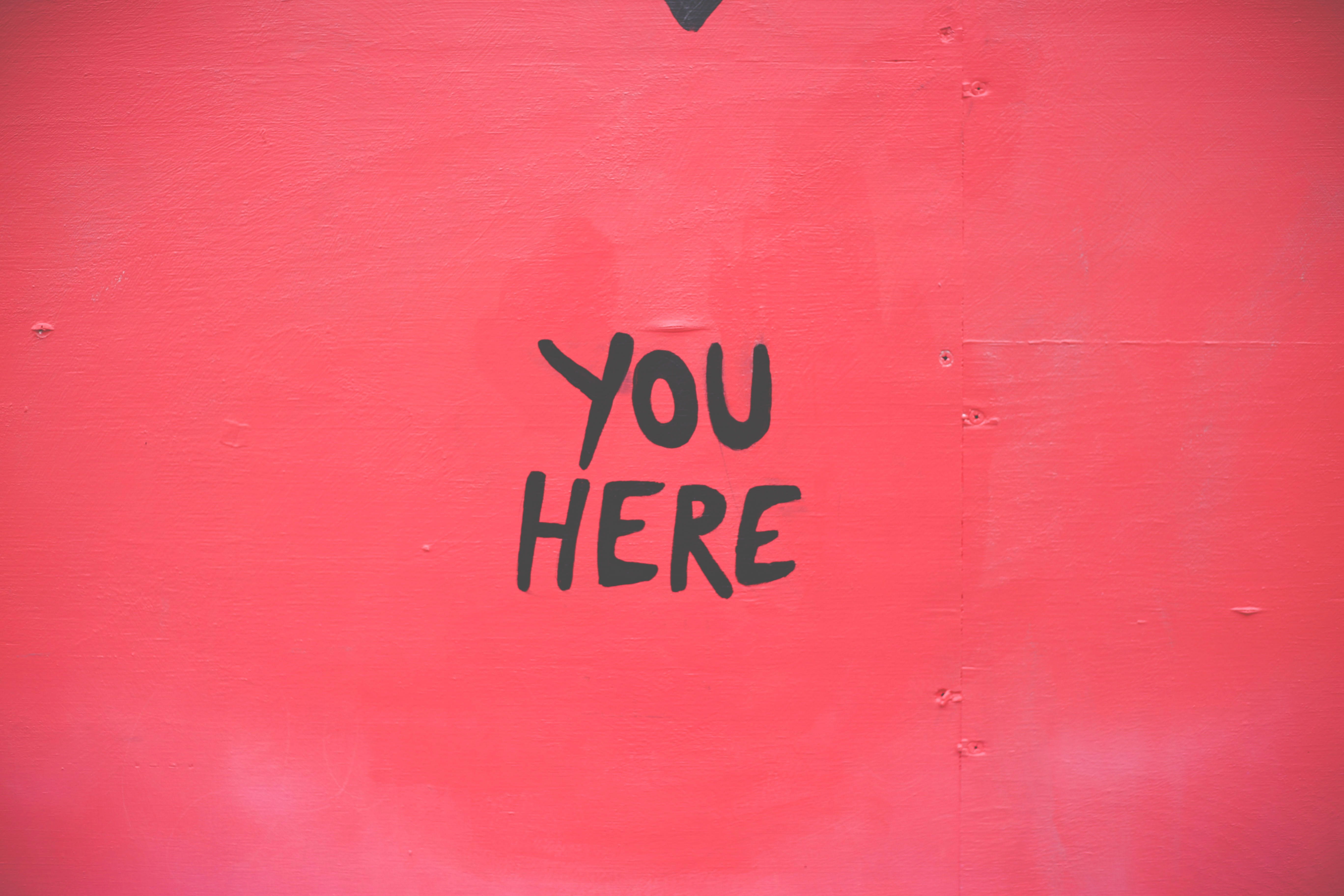 Street art writing you here on red plate at Venice Beach