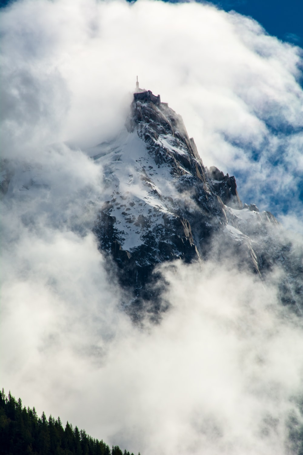 mountain hill covered with clouds
