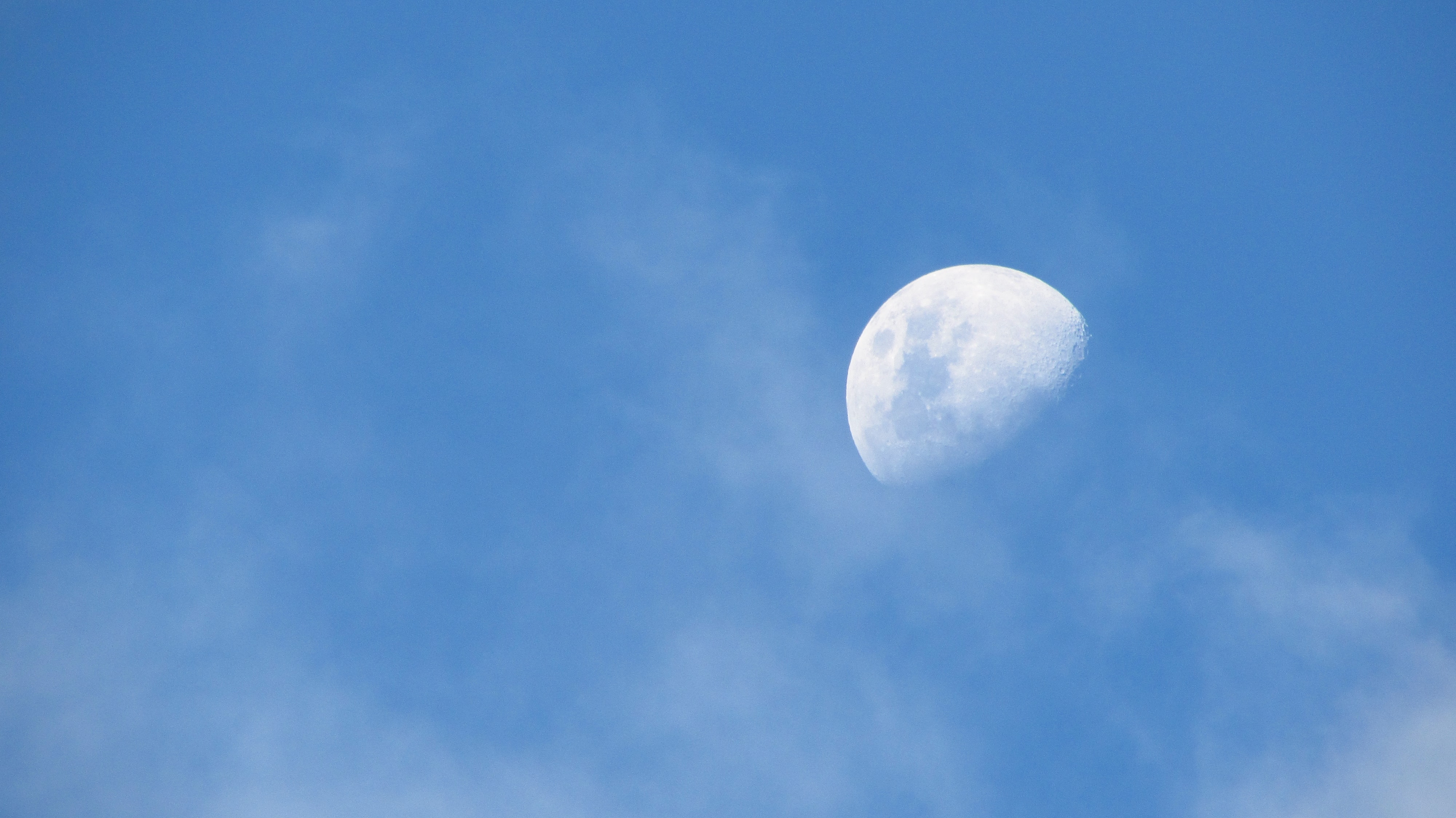 low angle photo of half-moon