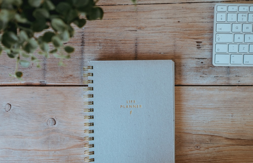 gray notebook on wood
