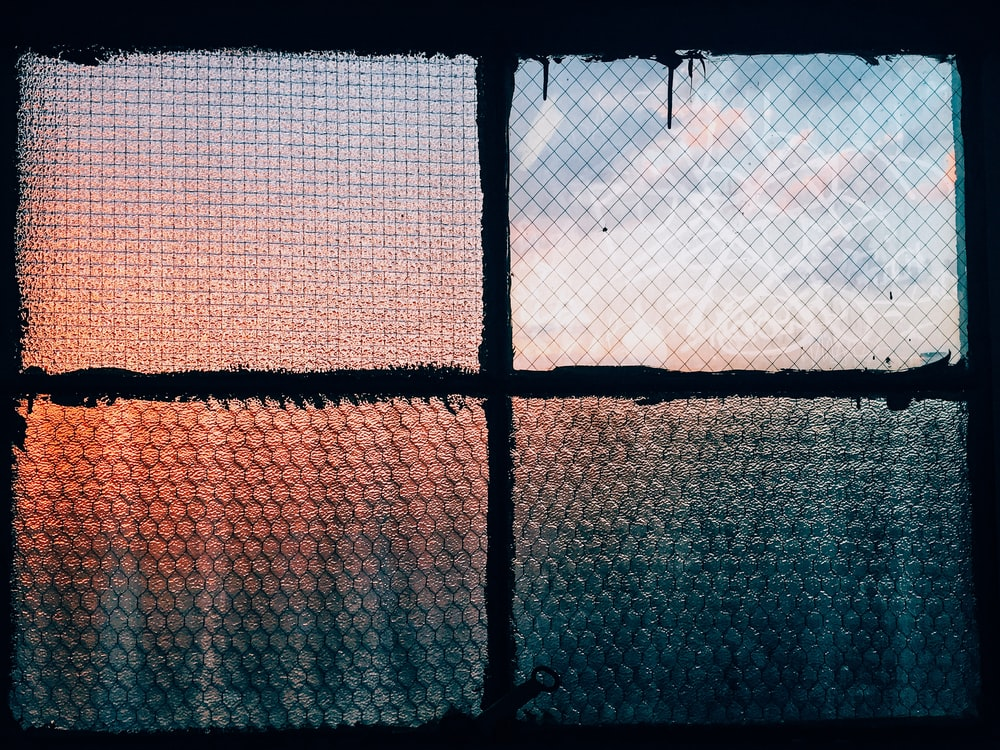 closeup photography of clear glass window closed