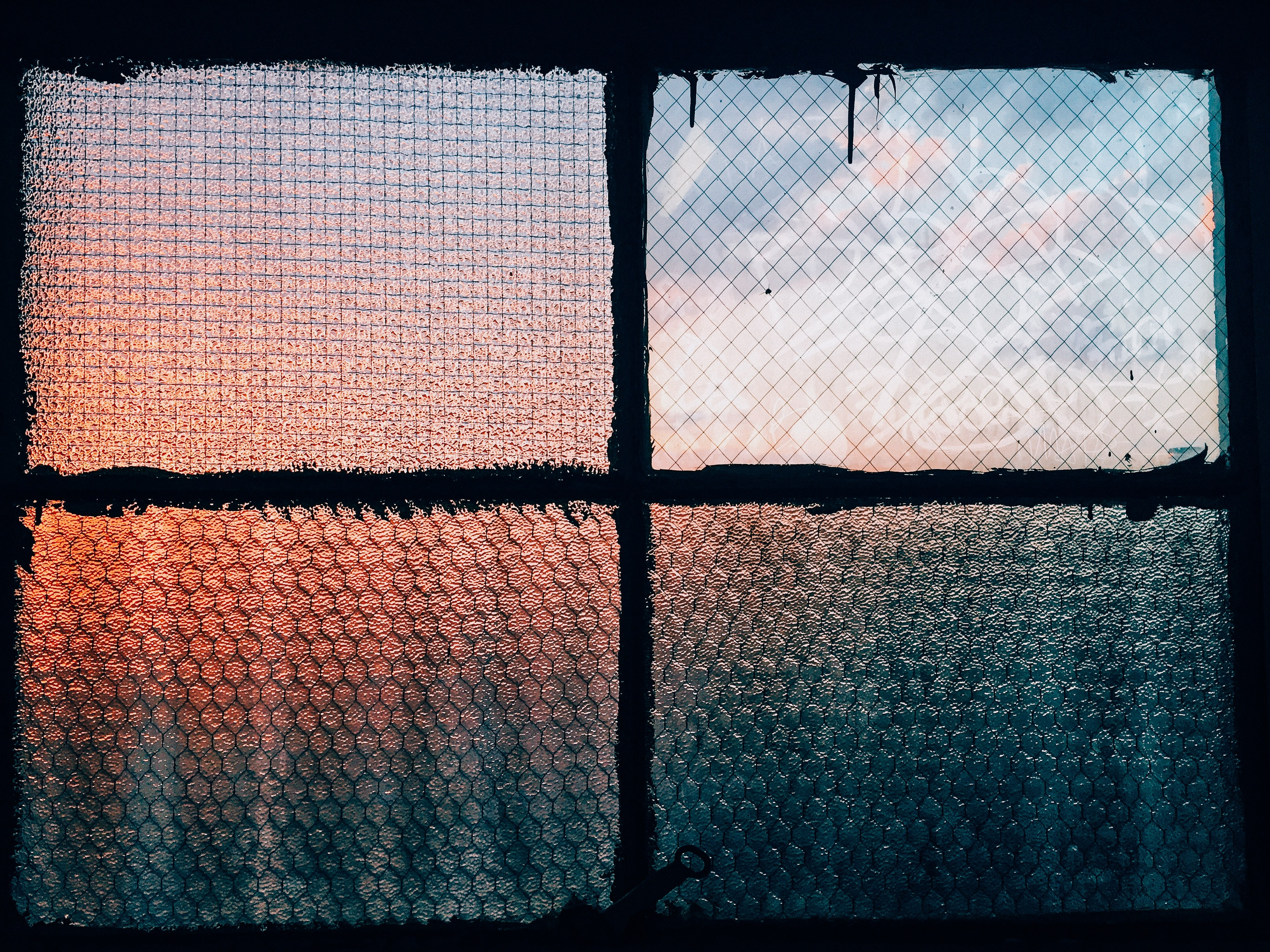 Textured sunset through the frosted window panes in Flatbush