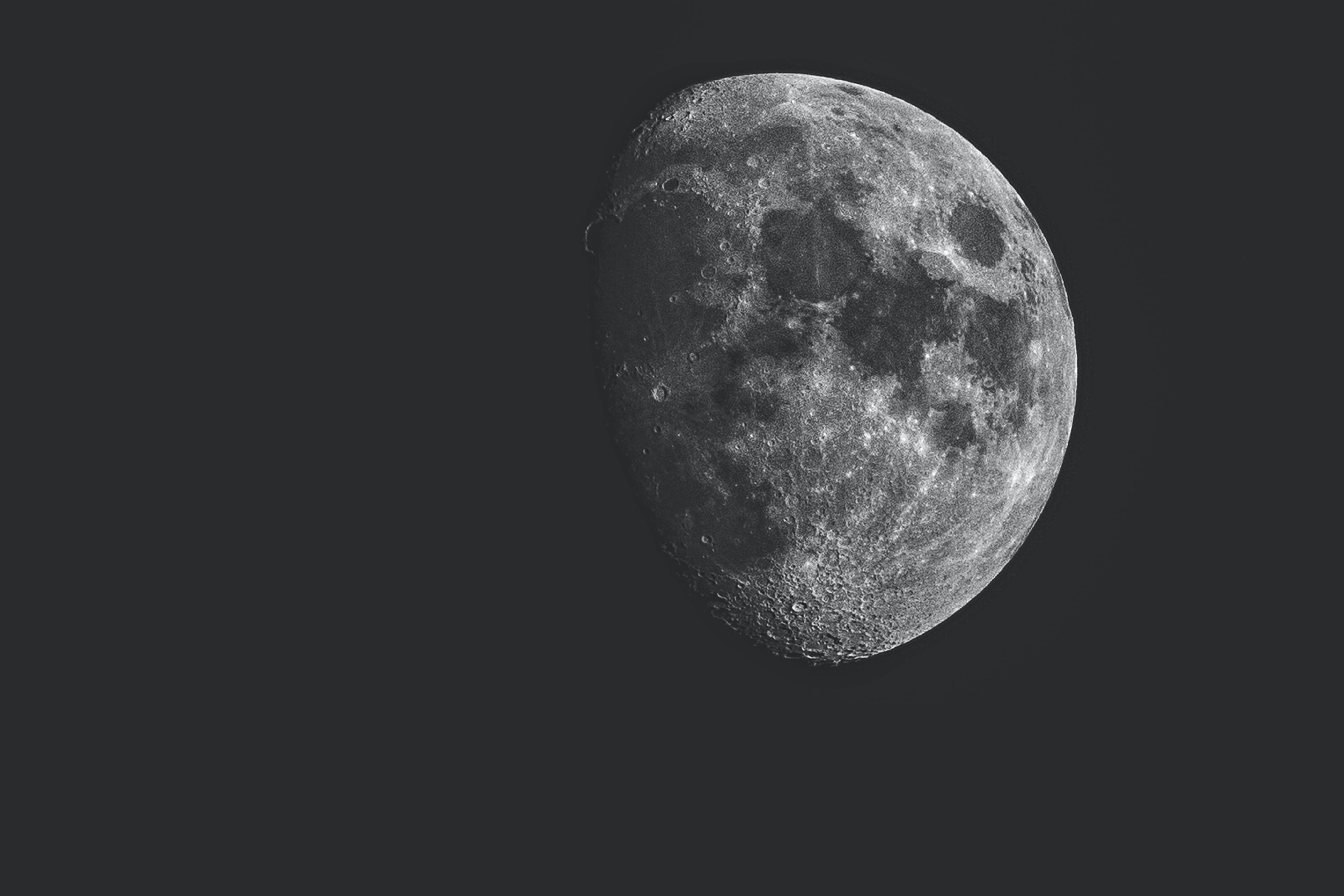 Close-up of the moon with lunar craters visible, as seen from Nove