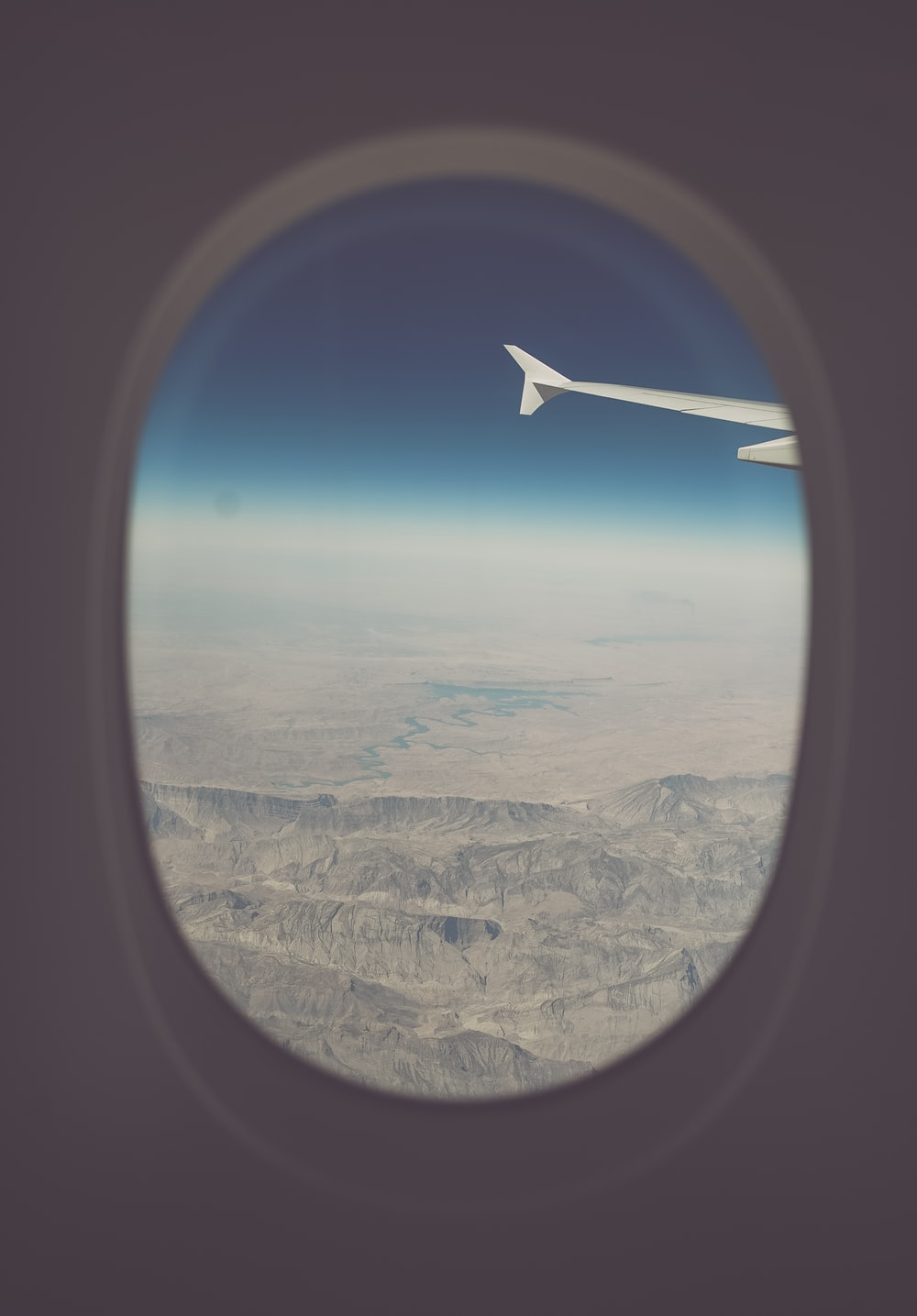 view of mountains from airplane window
