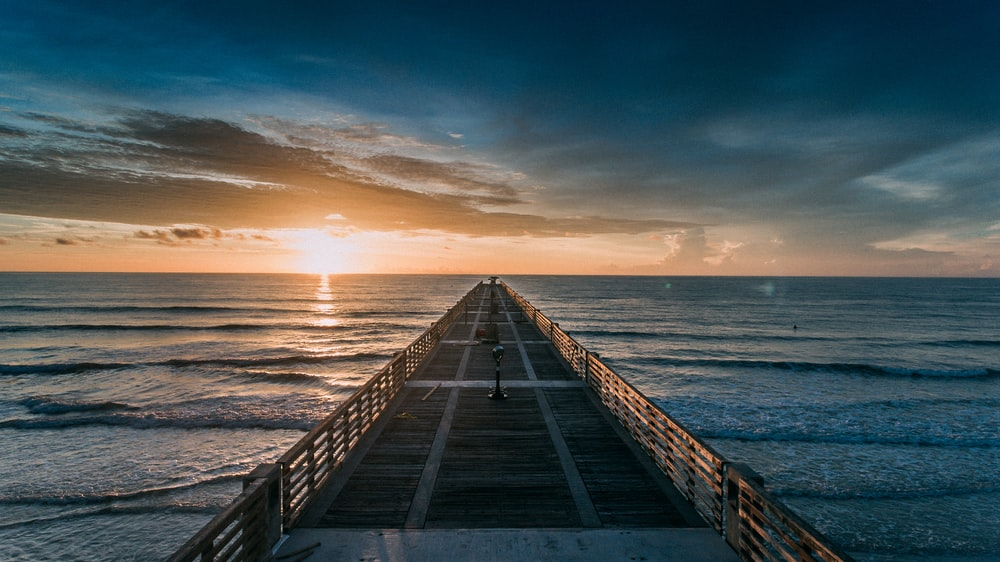empty dock at the beach during golden hour