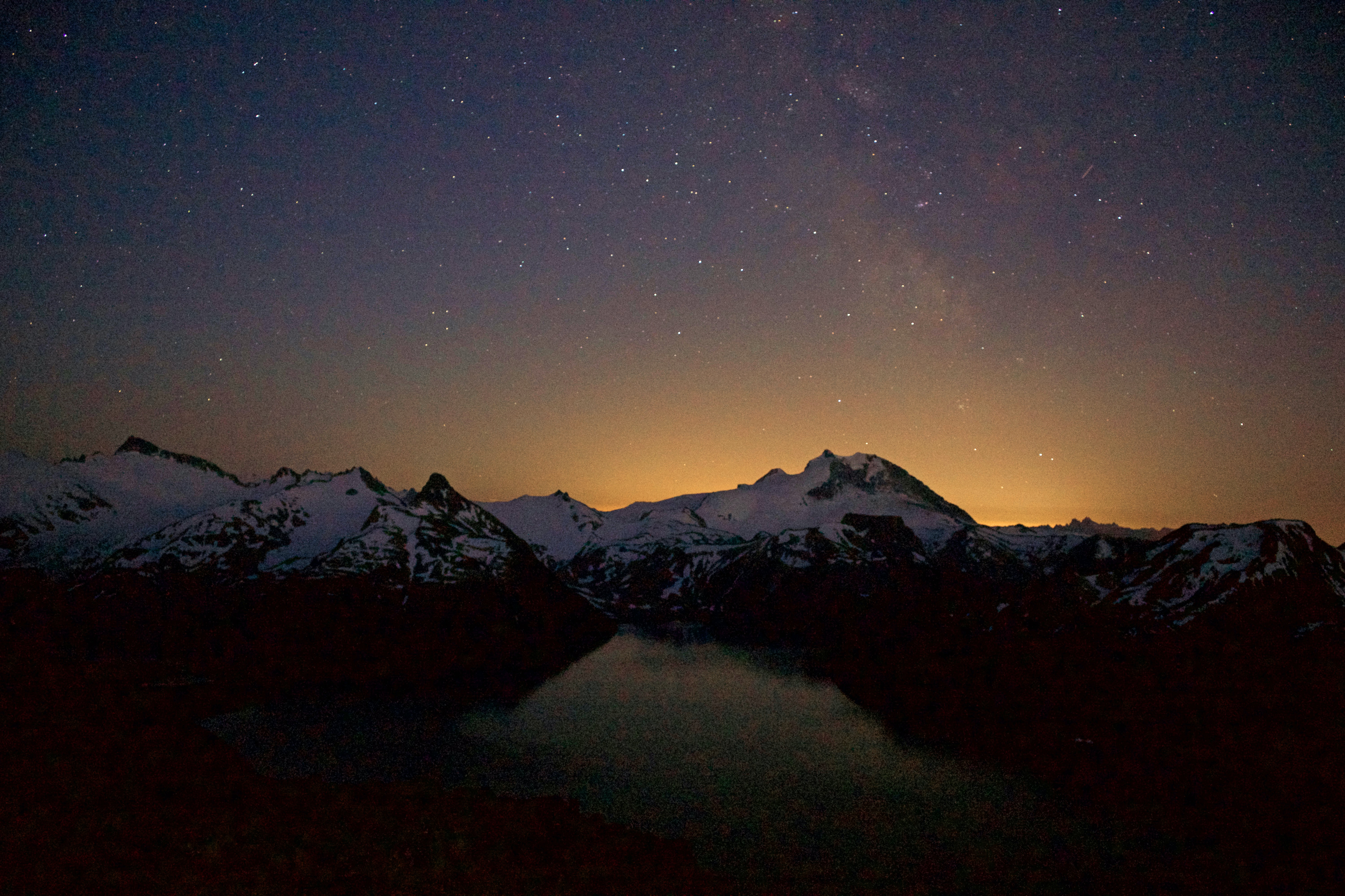 snow covered mountains at night