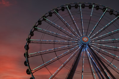 architectural photography of ferris wheel evening zoom background