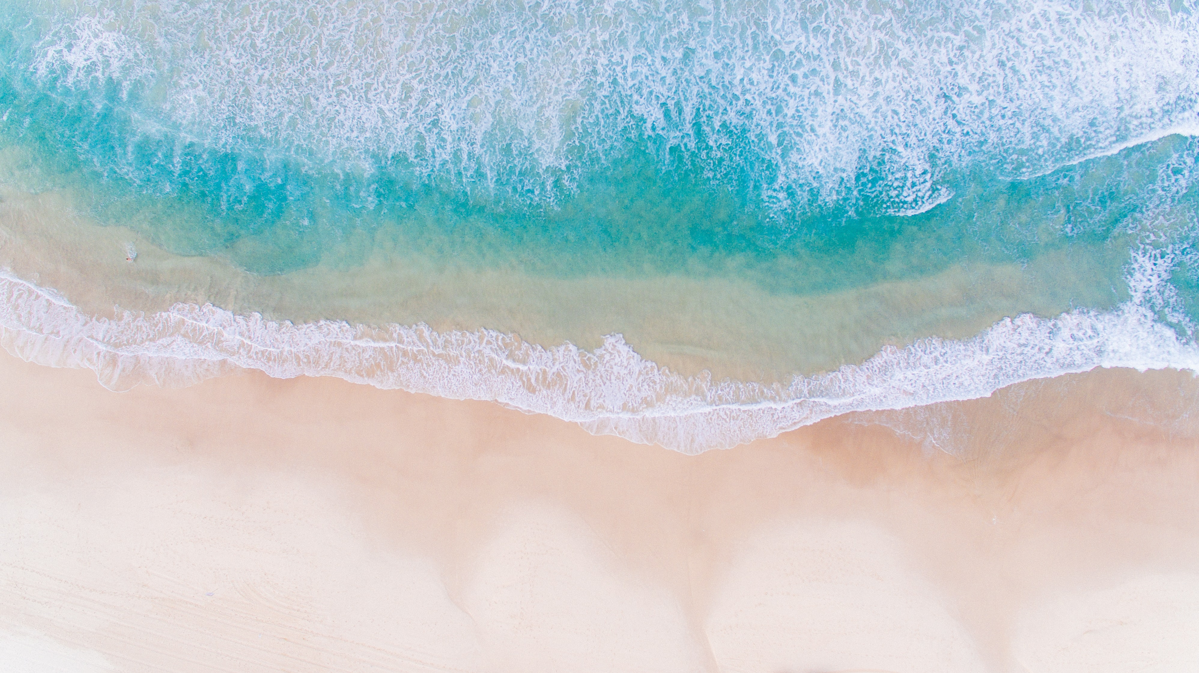 Drone view of the ocean washing on the Bondi Beach, New South Wales, Australia