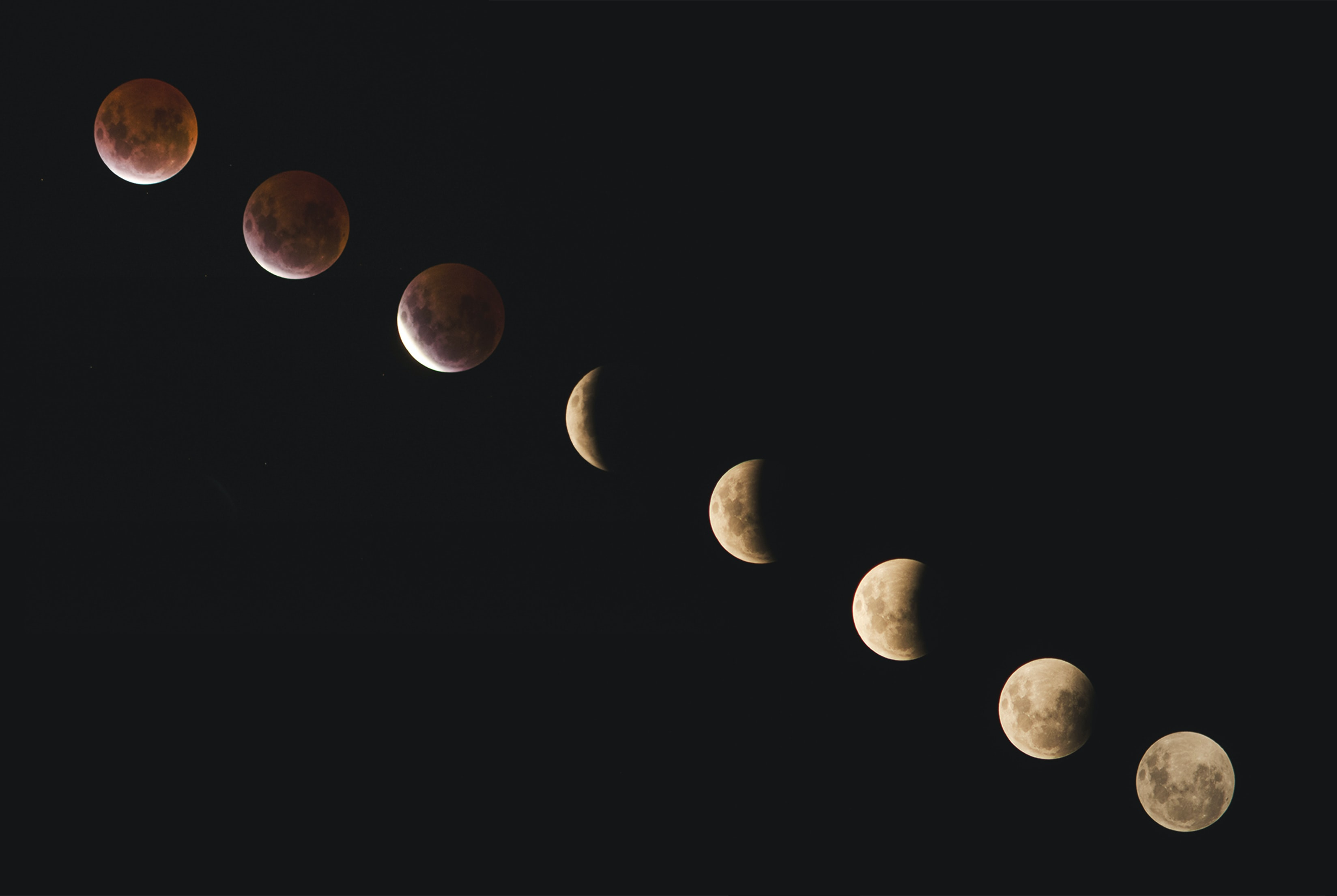 Long-exposure photograph of the phases of a lunar eclipse