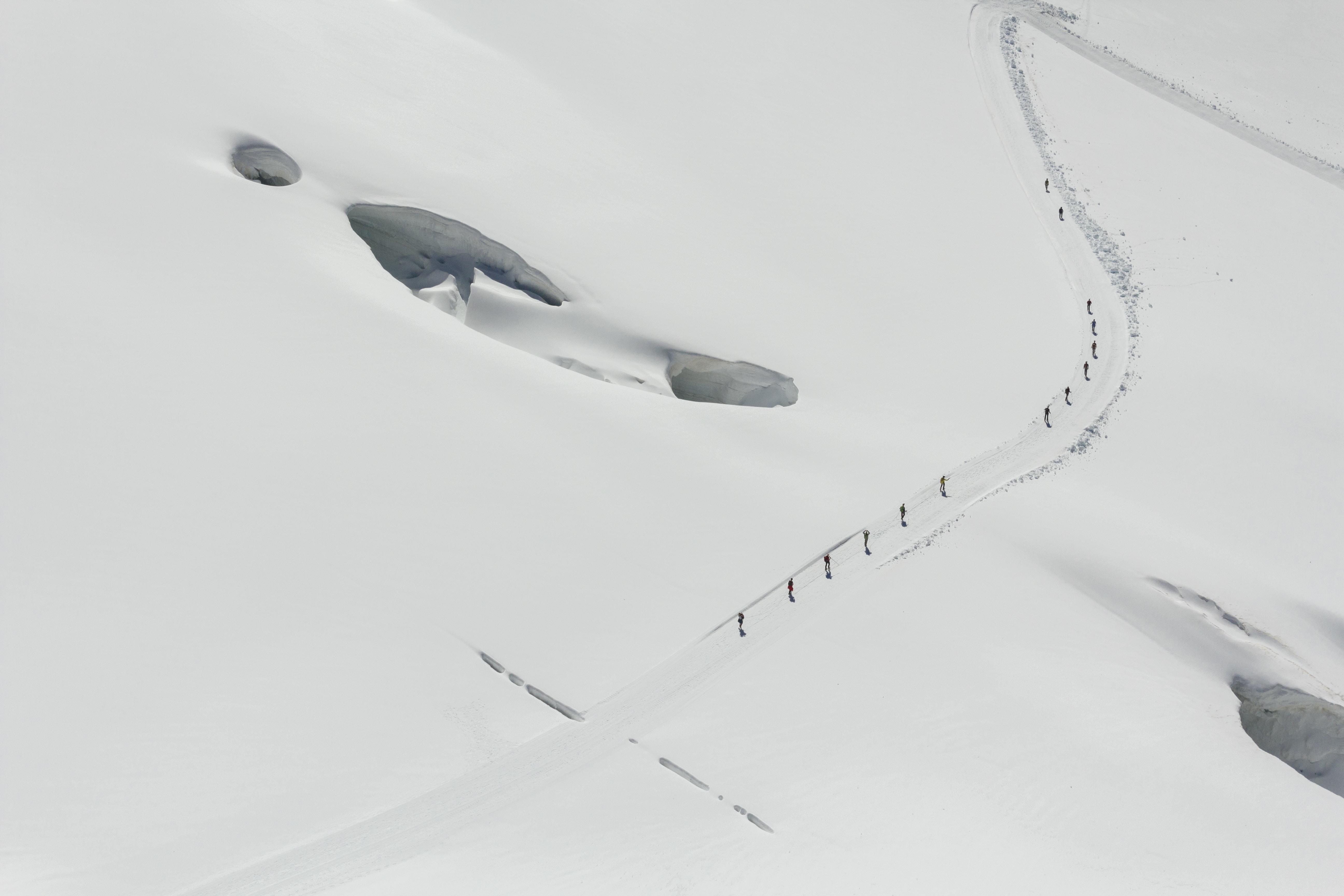 group of people walking on snow