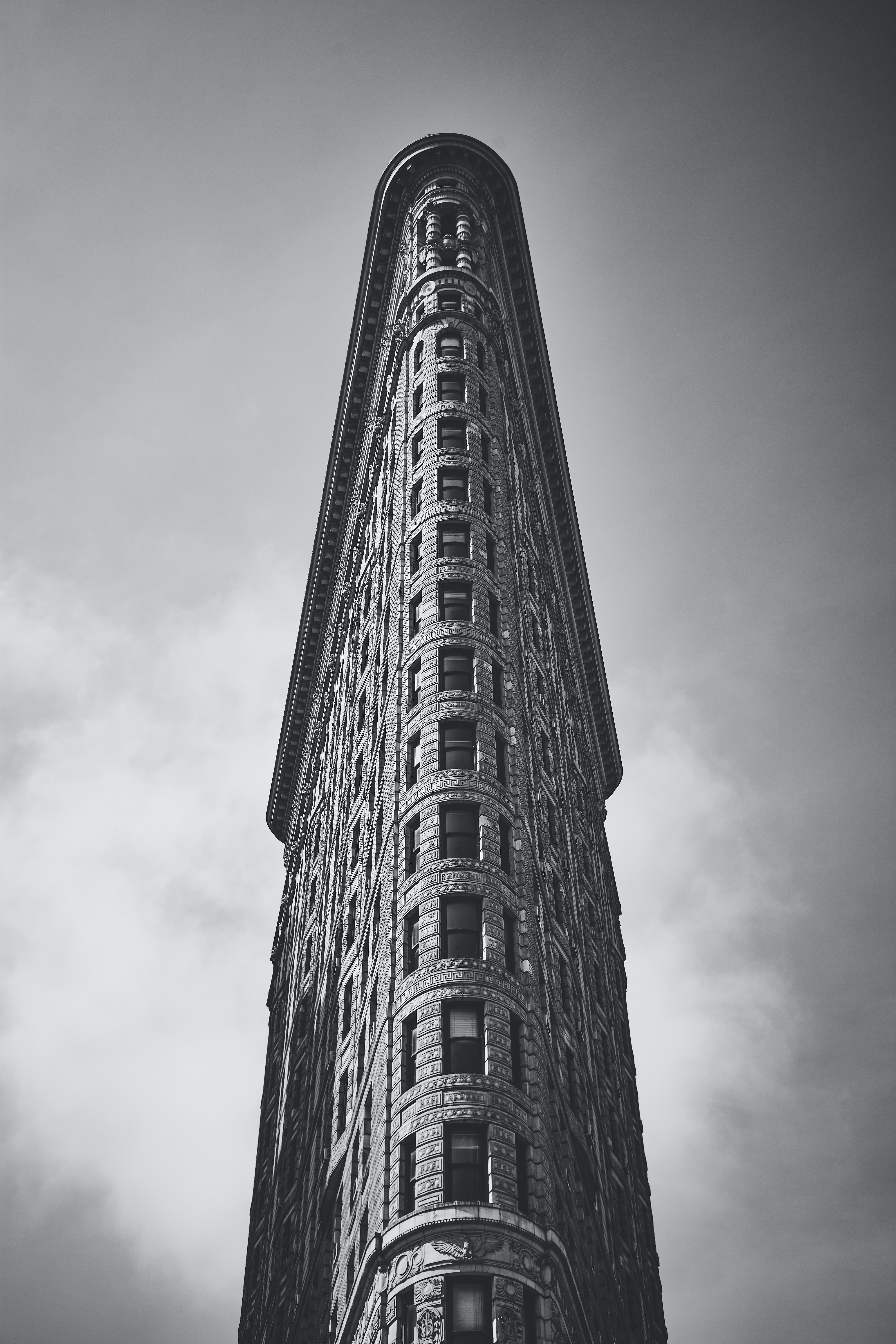A black and white photograph of the Flatiron Building, New York.