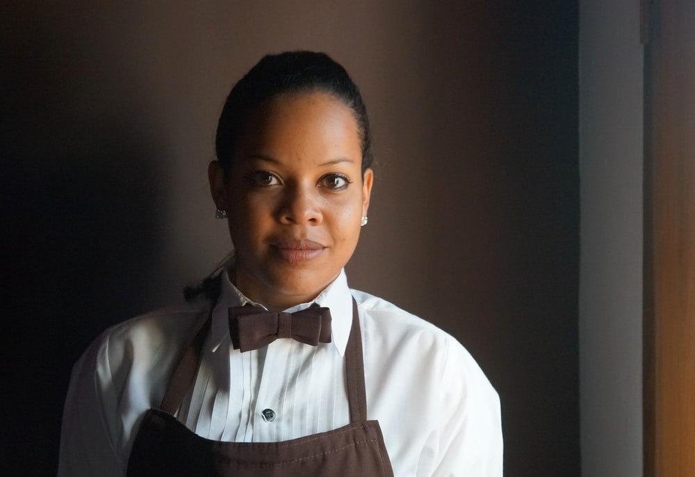 woman wearing brown apron
