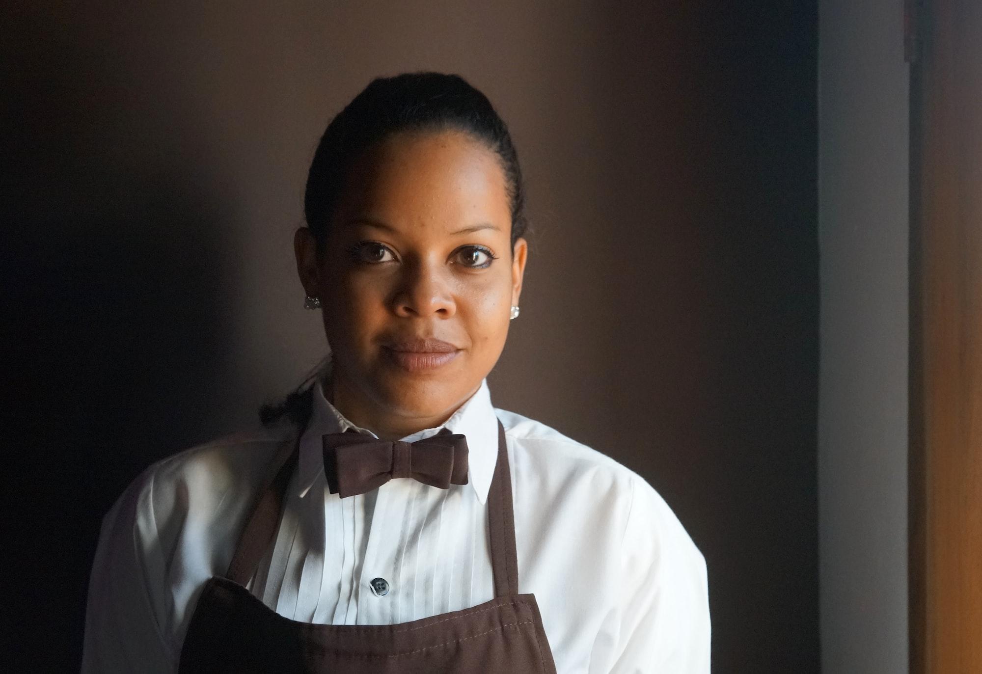 A waitress in her uniform.