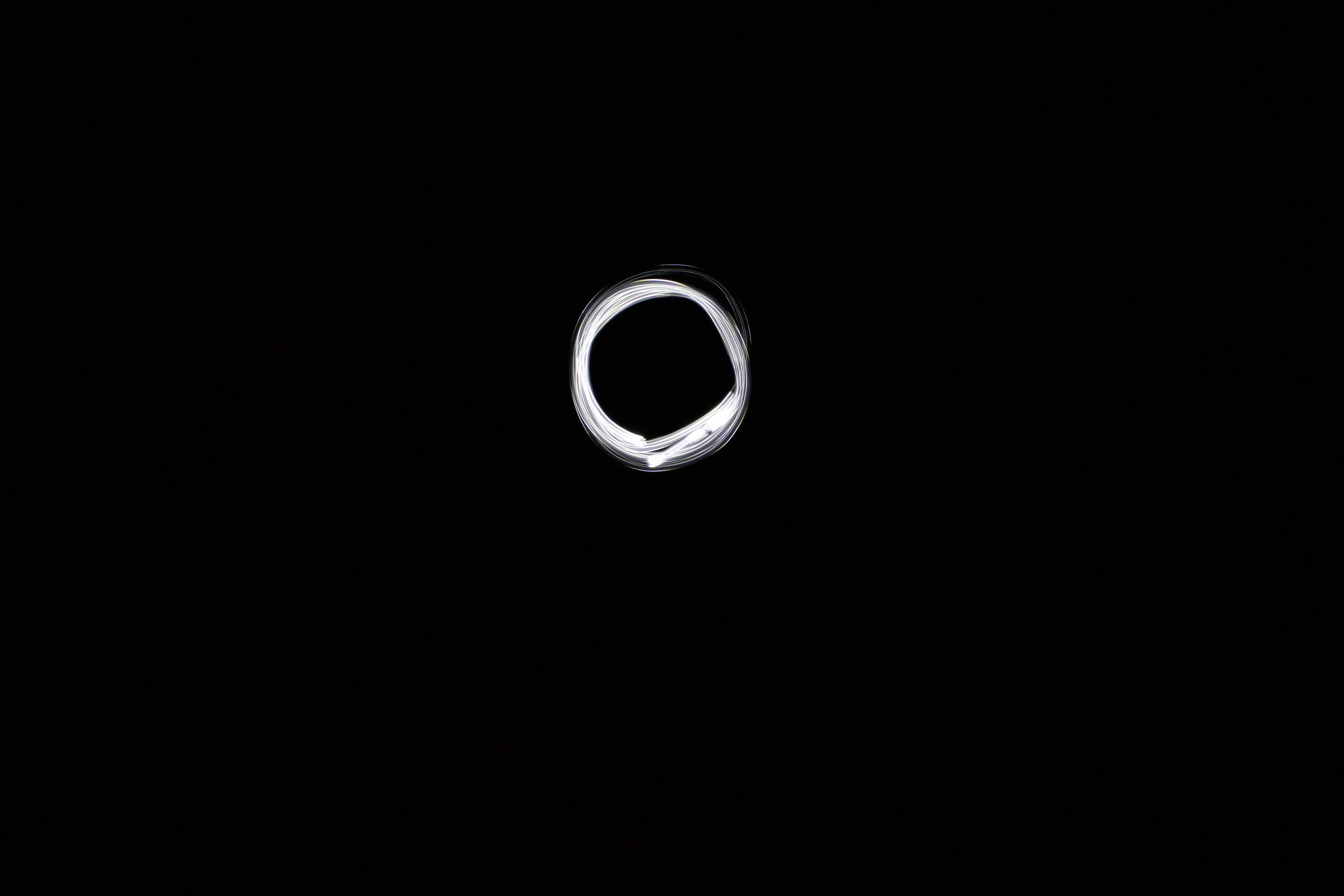 Spiral of white light in black background