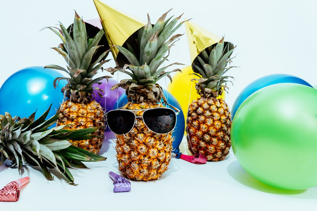 pineapples wearing house party hats