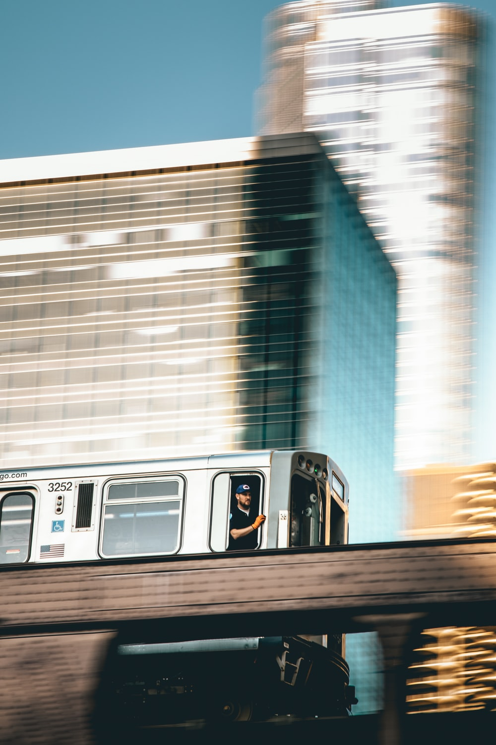 focus photography of person riding gray train