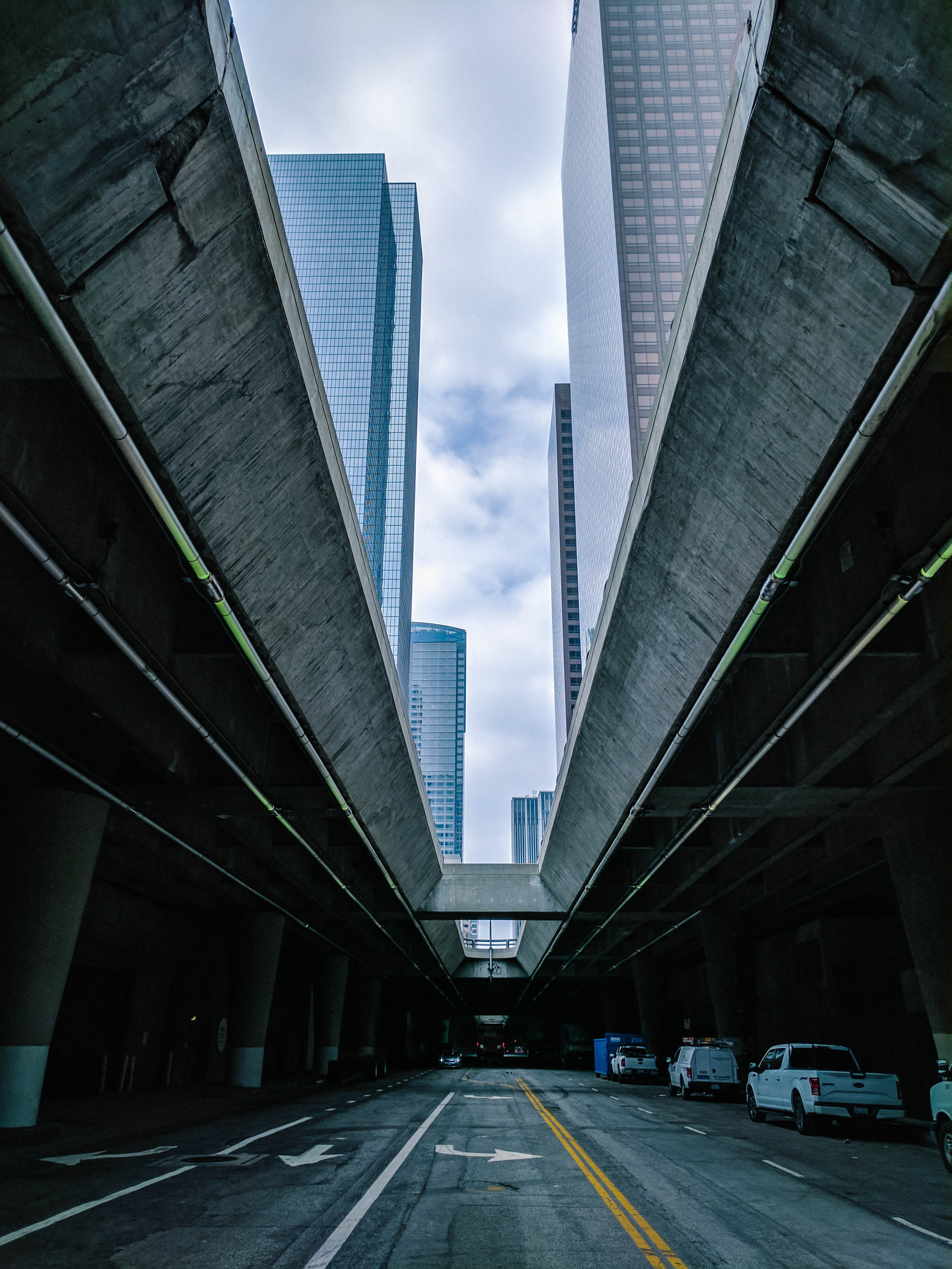 An urban city street with a long building facade shadowing above in Los Angeles