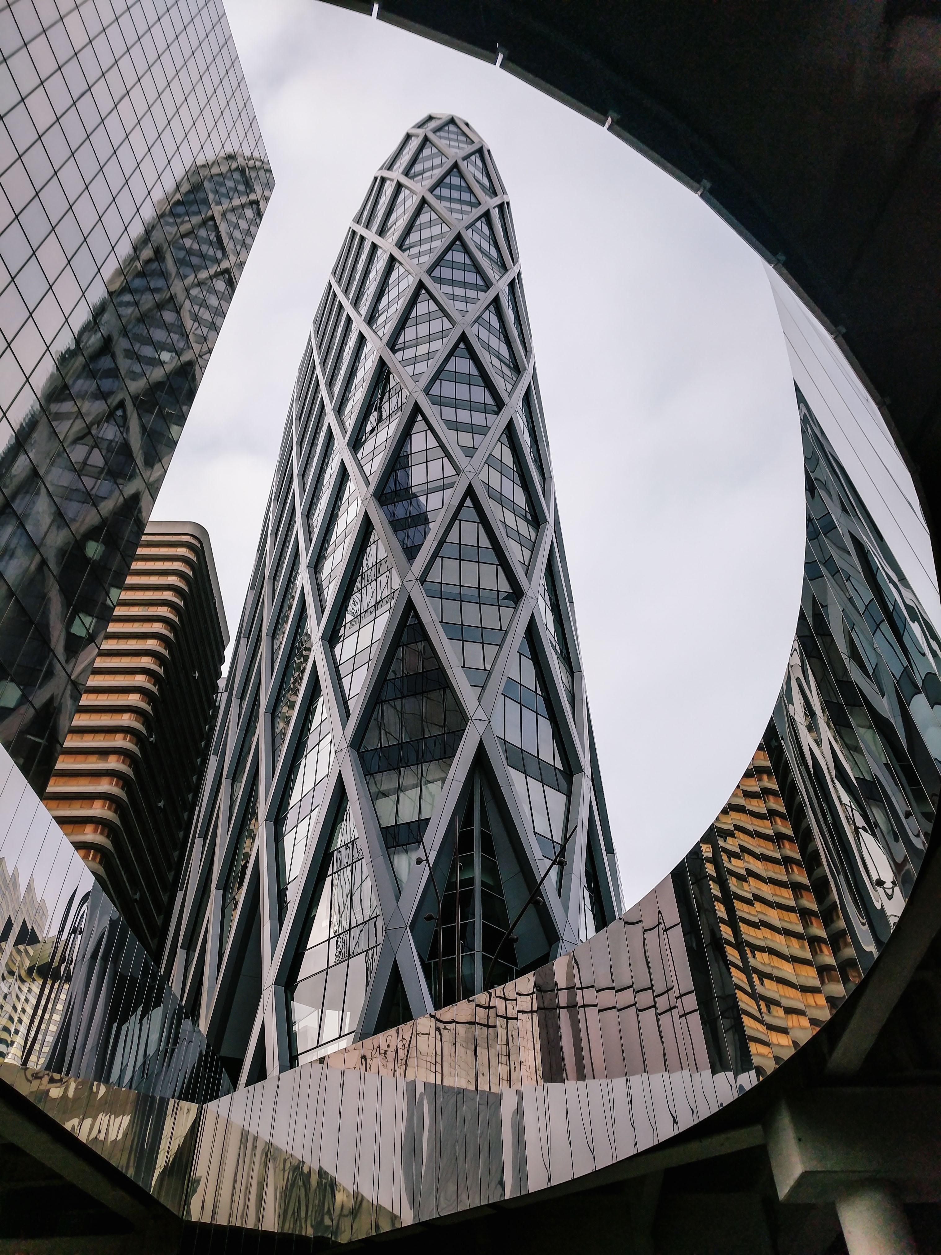 A tall modern skyscraper with a latticework facade in Paris