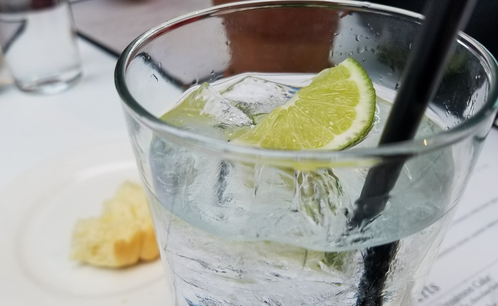 clear drinking glass with lemon slice
