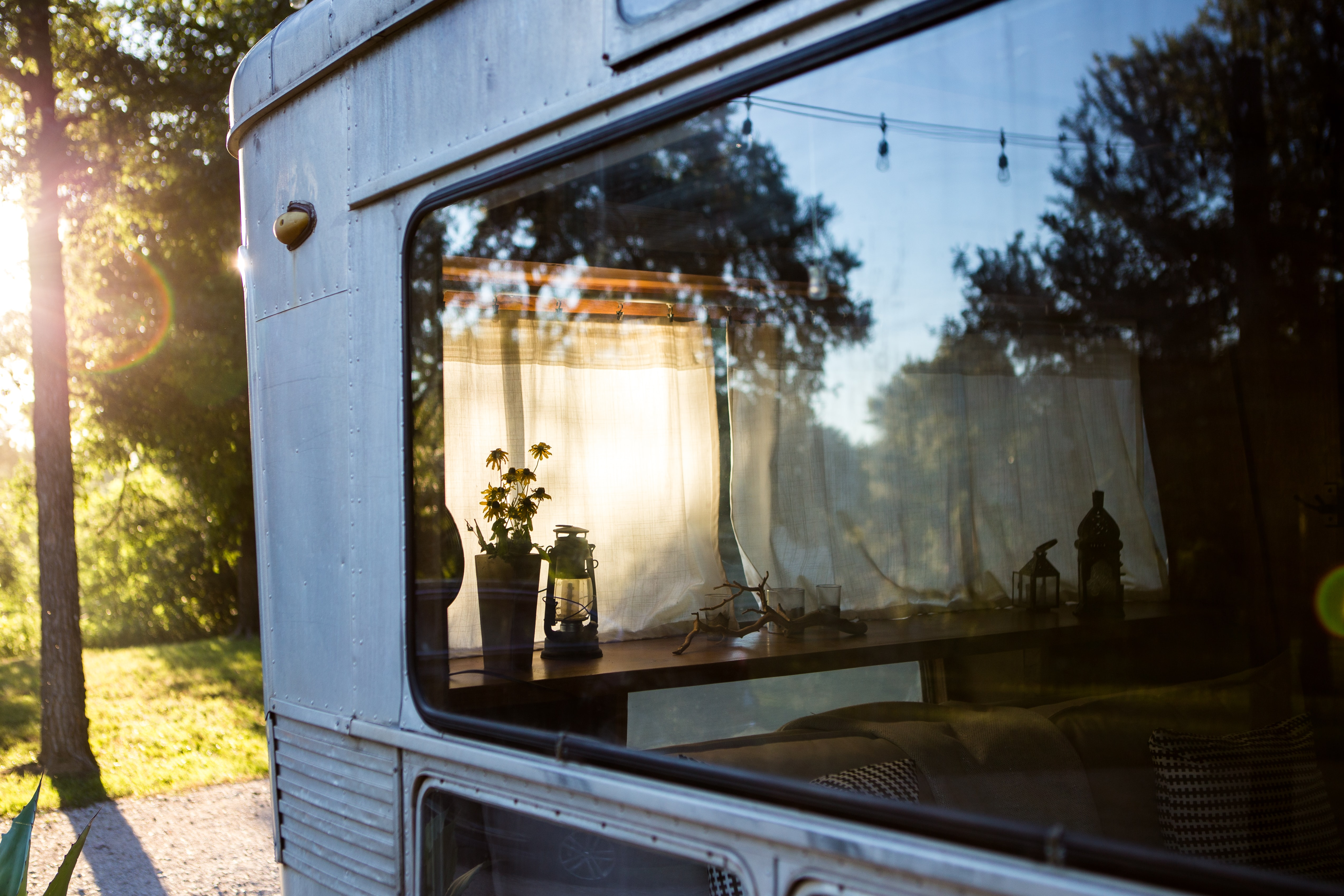 Looking in through a window of a mobile home with a vase on the counter