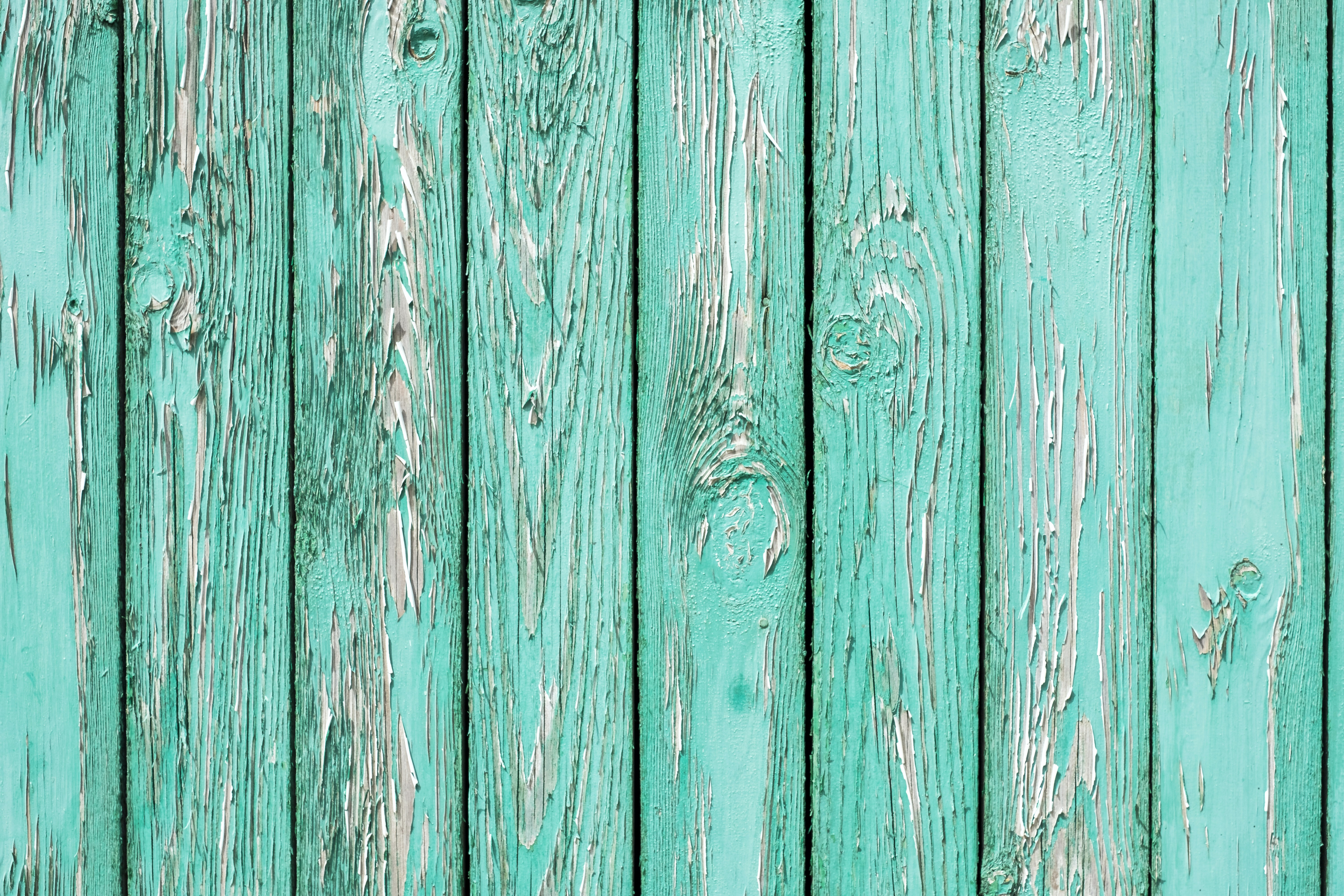 An old wooden wall painted turquoise