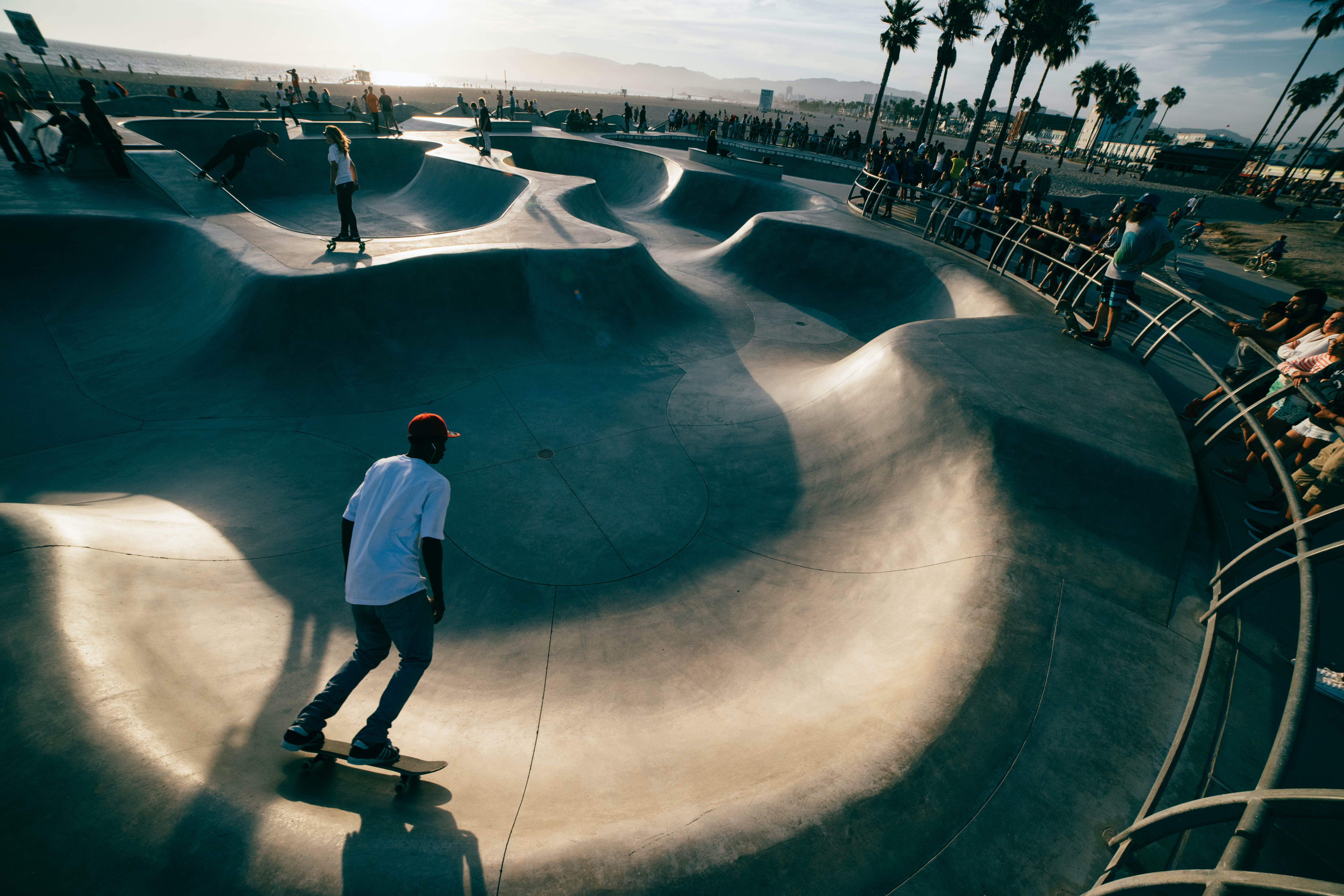 Man skateboarding in Venice Skate Park during sunset