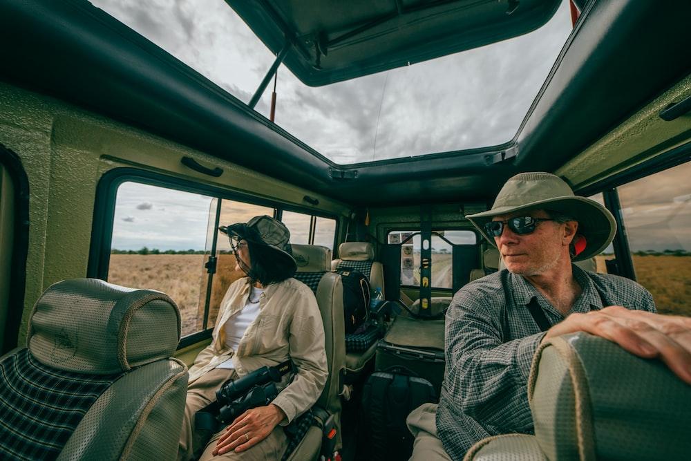 man and woman sitting inside car