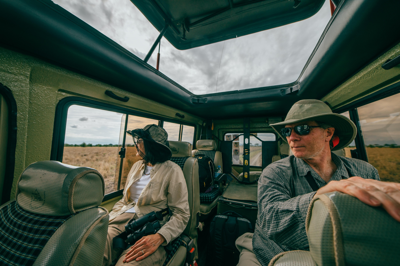 Tourists take a safari ride in a truck in Tanzania