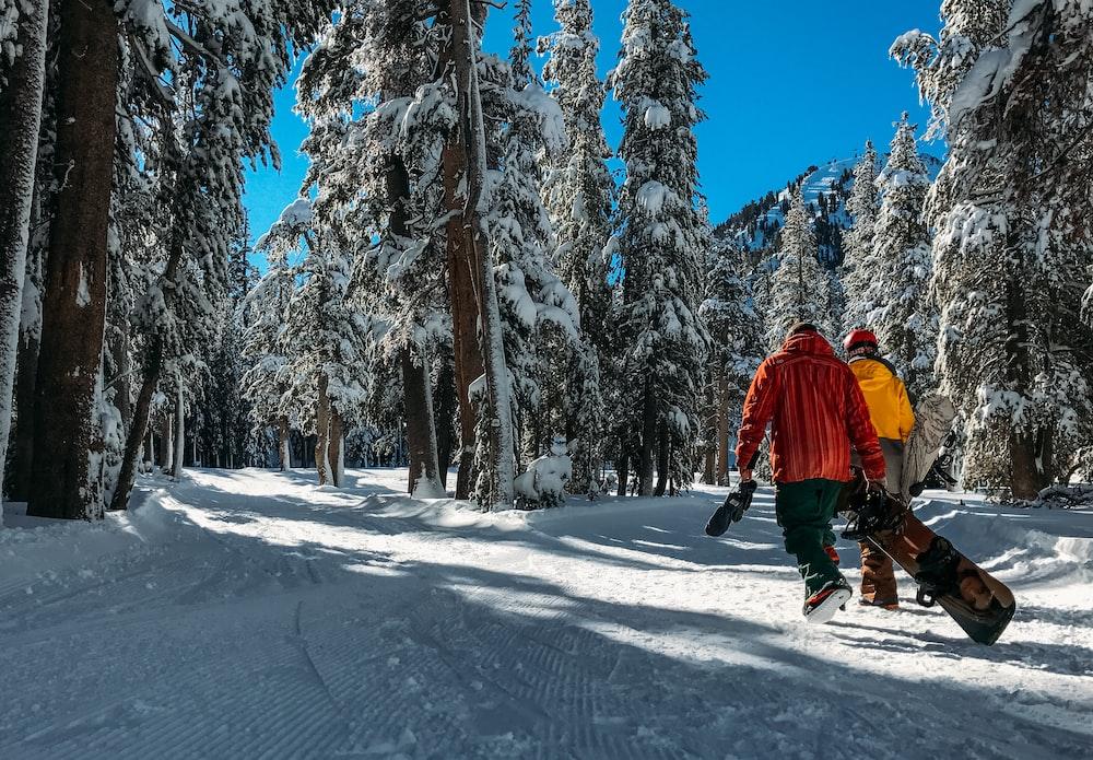 two men walking on snow