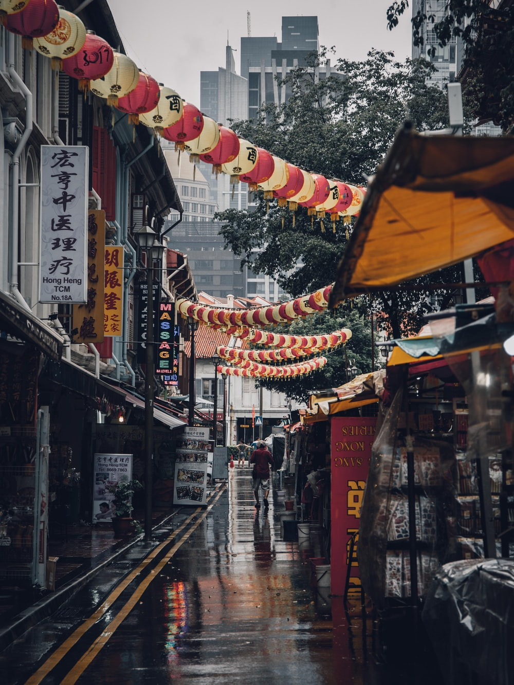 assorted lanterns hanged above alleyway